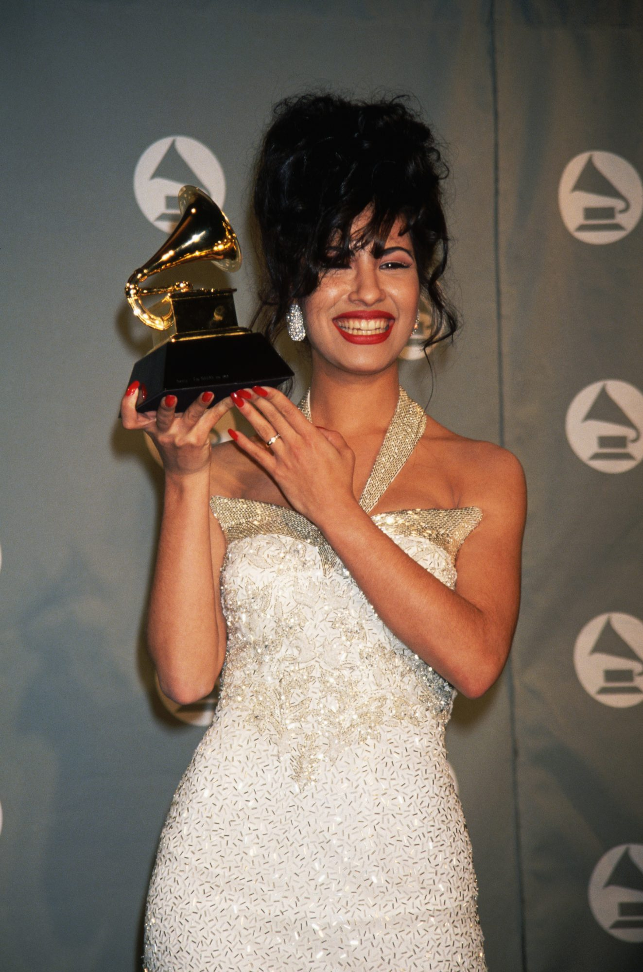 Selena Holding Grammy
