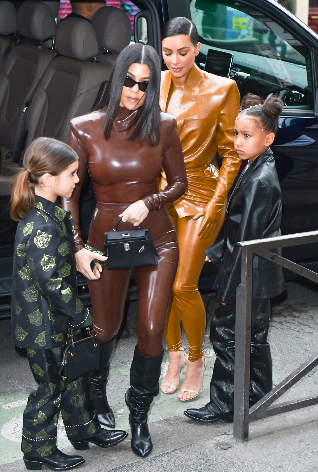 Kim Kardashian and sister Kourtney Kardashian arrive at the Bouffe Du Nord Church/Theatre for Sunday service with Kanye West on March 1st 2020 in Paris, France.