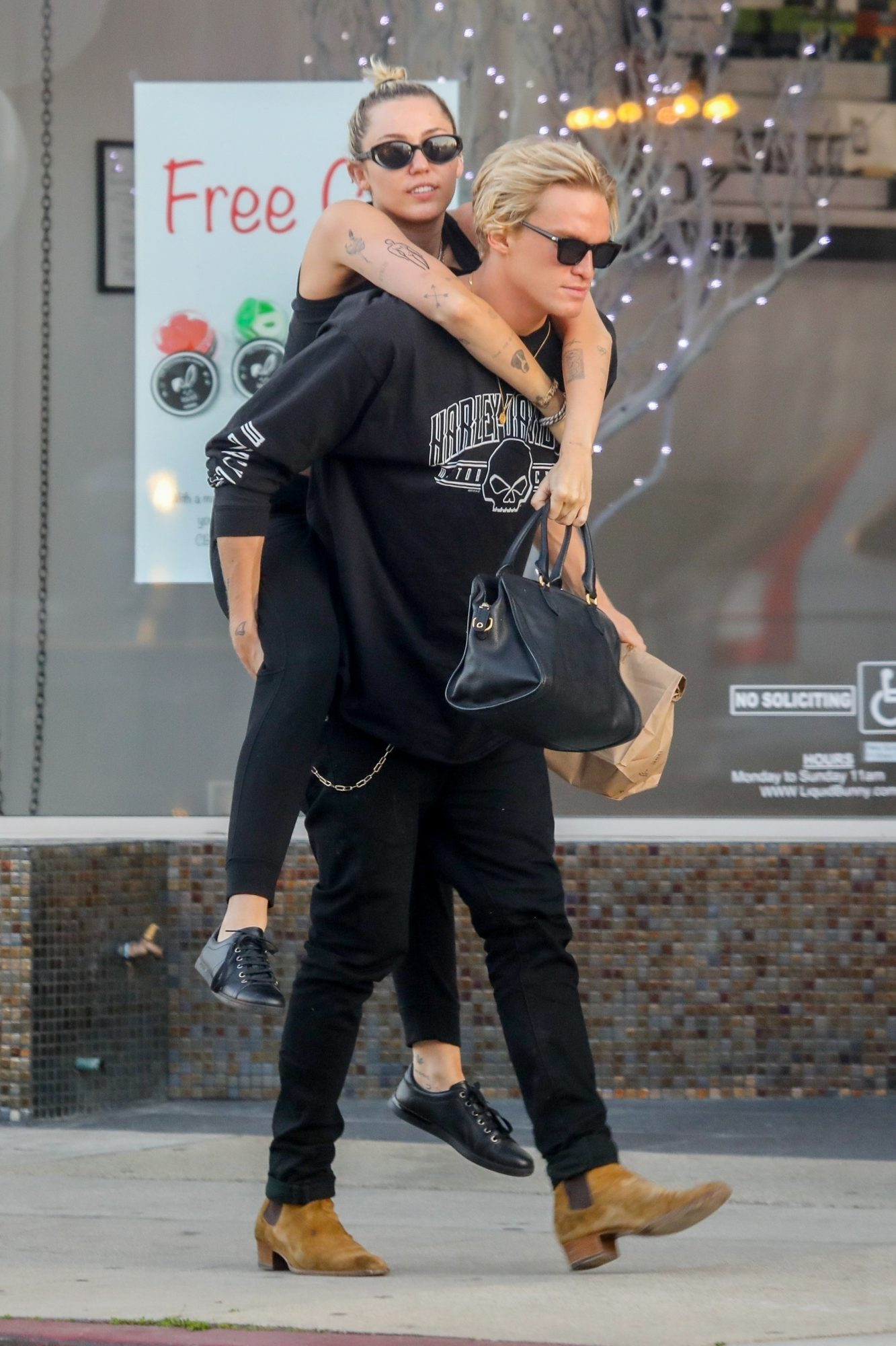 Cody Simpson gives his girlfriend Miley Cyrus a piggy-back-ride after lunch at Electric Karma Indian restaurant in West Hollywood, after spending three hours at a face spa in Beverly Hills.