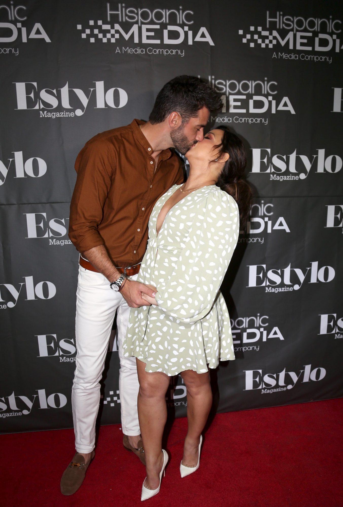 Adamari López y Toni Costa en un evento