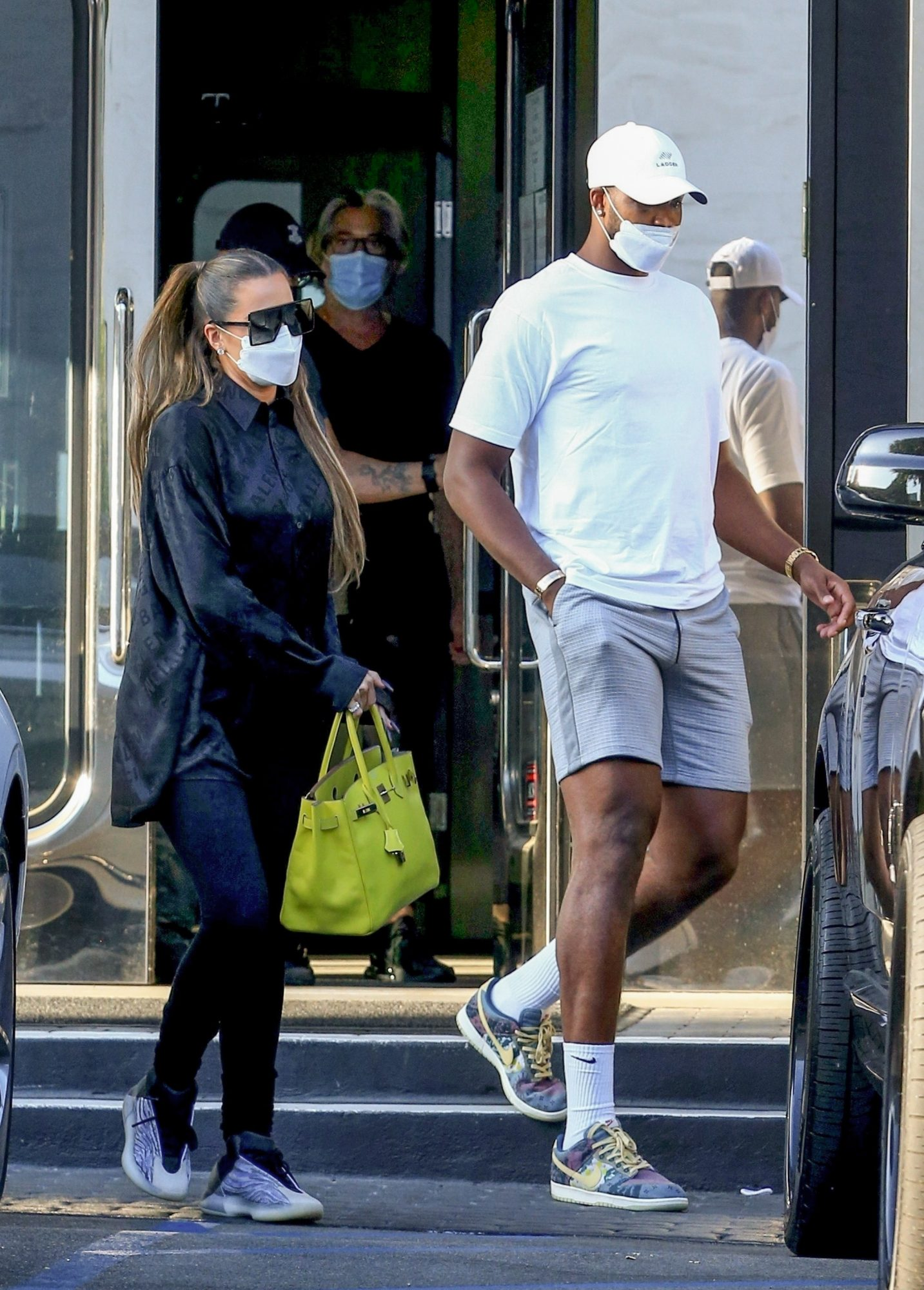 Khloe Kardashian and Tristan Thompson return to their Rolls Royce after some shopping at XIV Karats Ltd in Beverly Hills