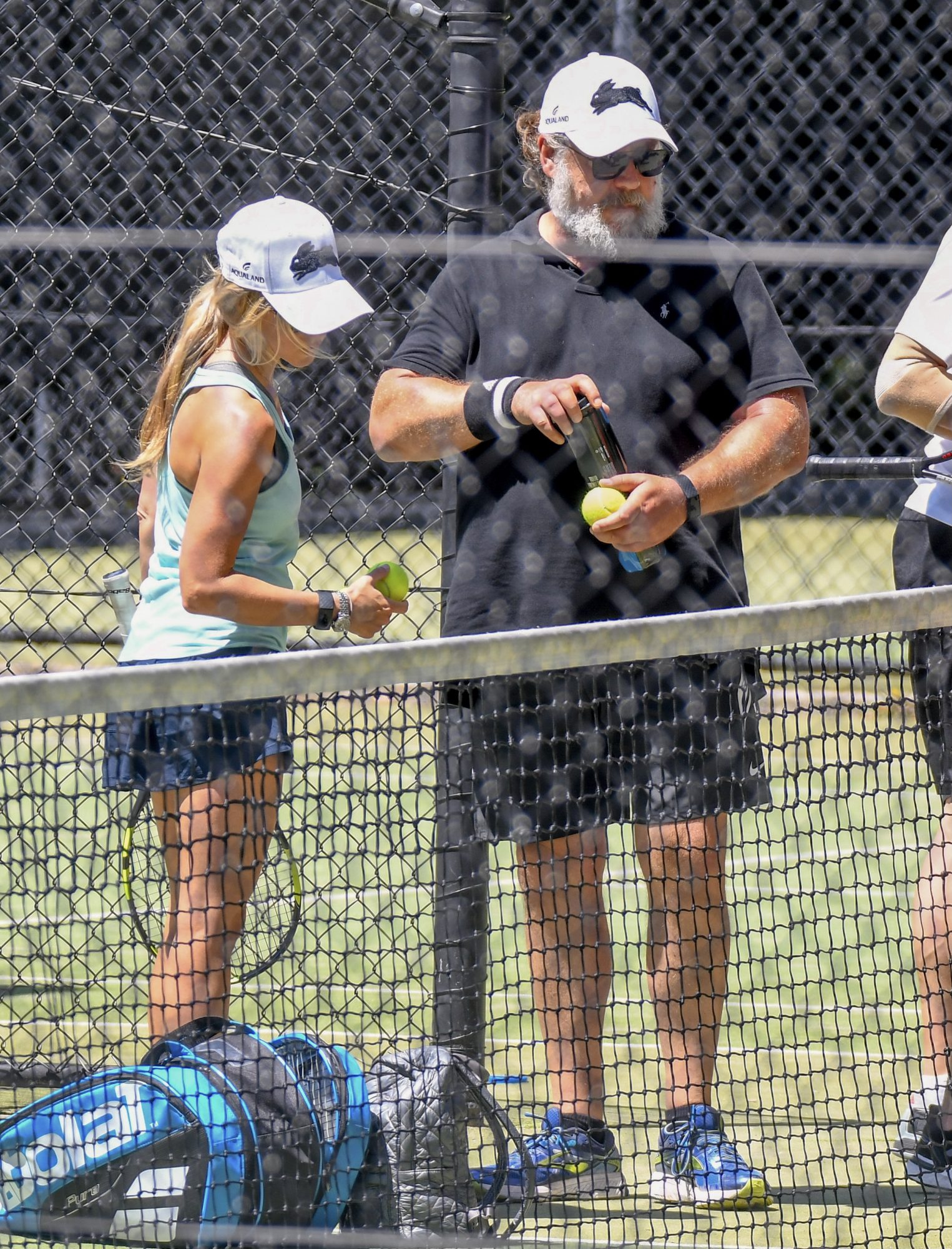 Russell Crowe and his 30 Year Old Girlfriend, Britney Theriot, on the Tennis Court