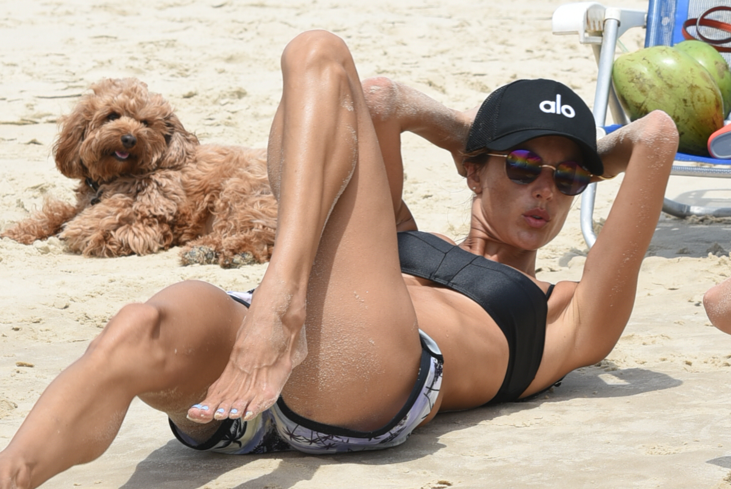 Alessandra Ambrosio Seen Exercising On The Beach With Her Personal Trainer