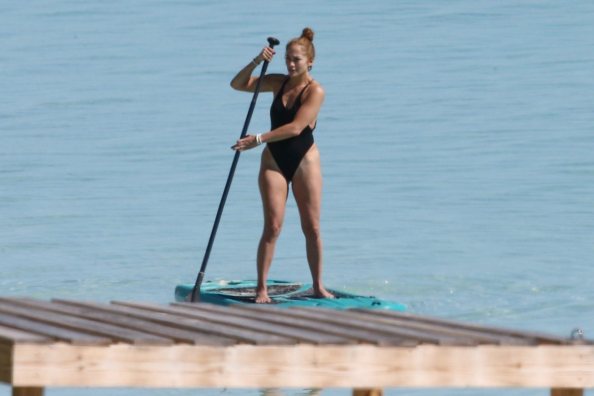 Jennifer Lopez paddleboard bathing suit celulitis