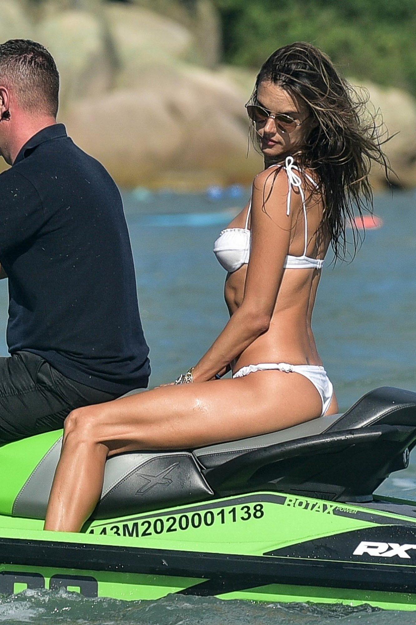 Alessandra Ambrosio Slips into a white Bikini to Ride a Jet Ski in Brazil