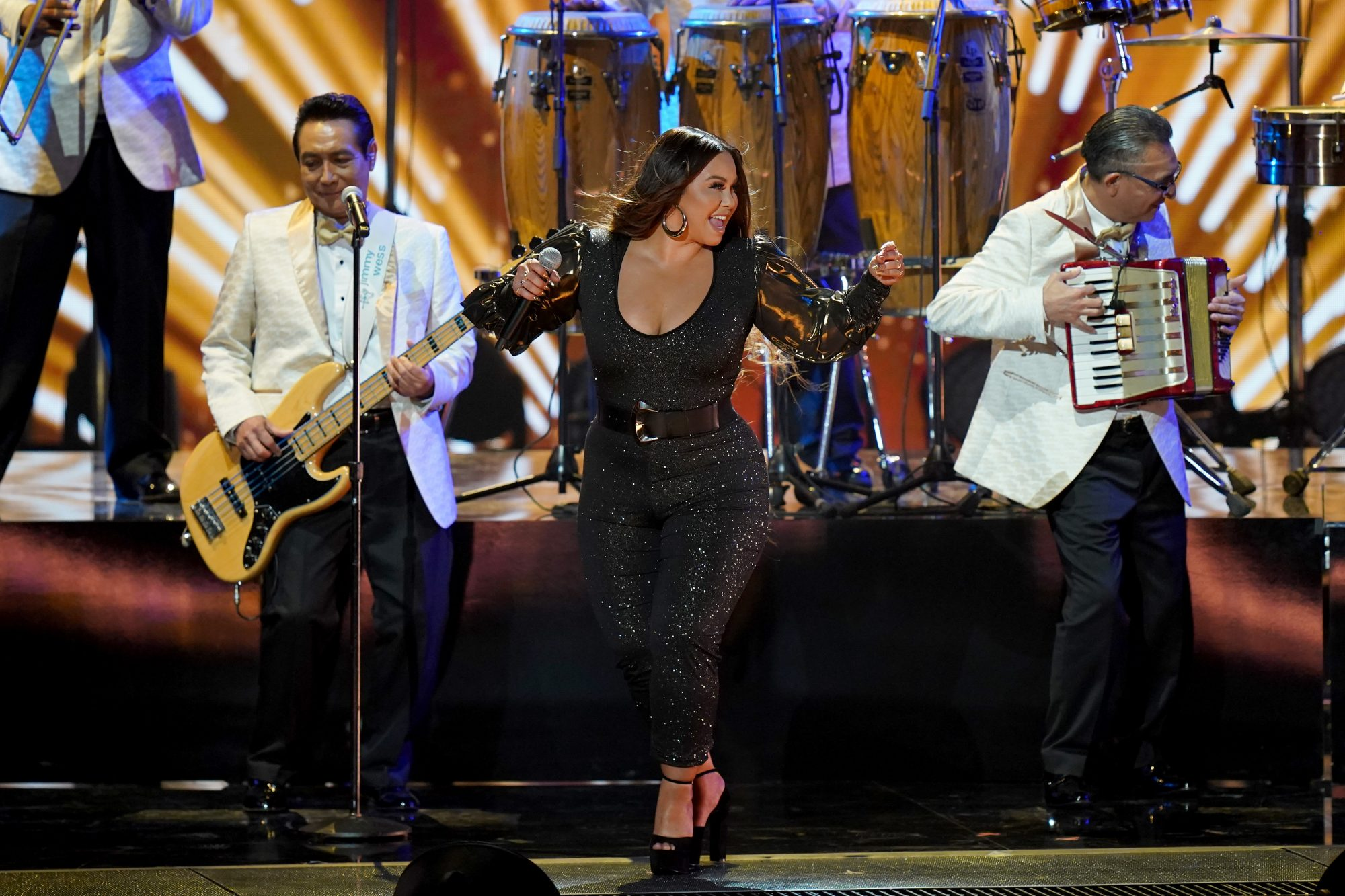 """Chiquis joined legendary cumbia band Los Ángeles Azules to perform """"El Listón de Tu Pelo."""" The band received the Musical Legacy award. """"Thank you Premio Lo Nuestro for this recognition. It's been 40 years and we want to thank our family and all of our Hispanic fans. Let's give them a round of applause,"""" they said in their speech."""