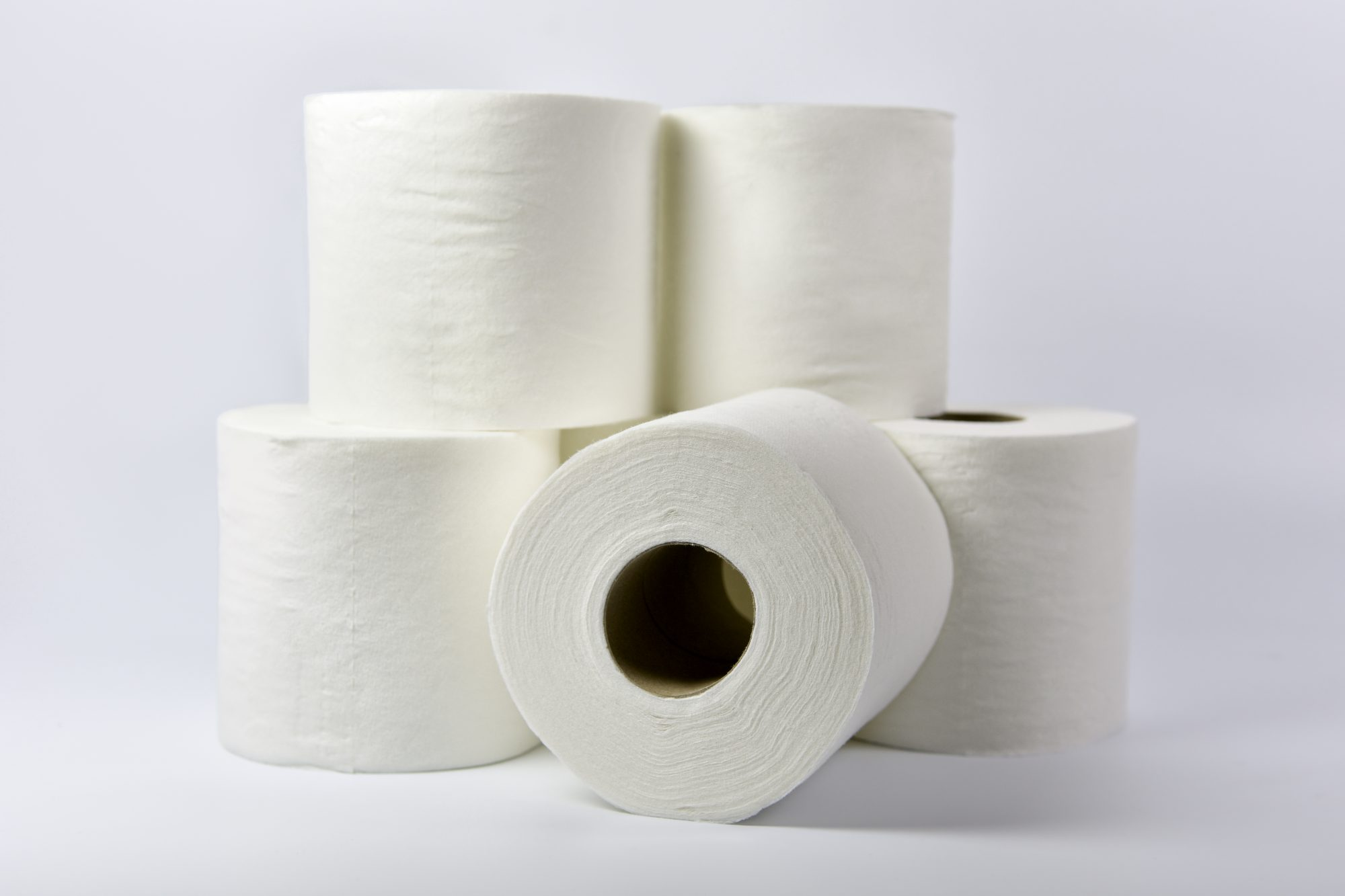 White toilet rolls on a white background
