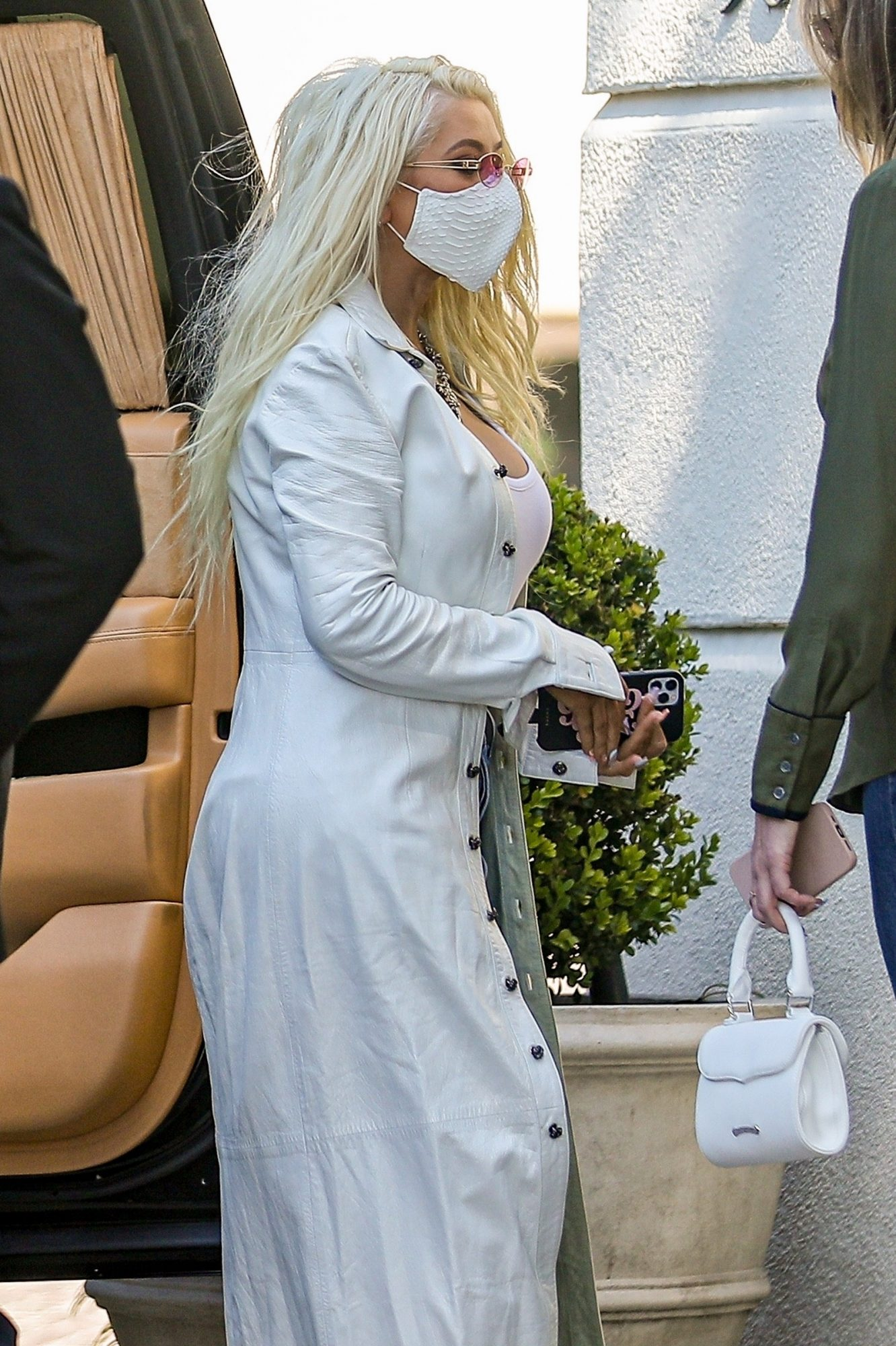 Christina Aguilera in Long White Coat Arrives at The Peninsula Hotel in Beverly Hills