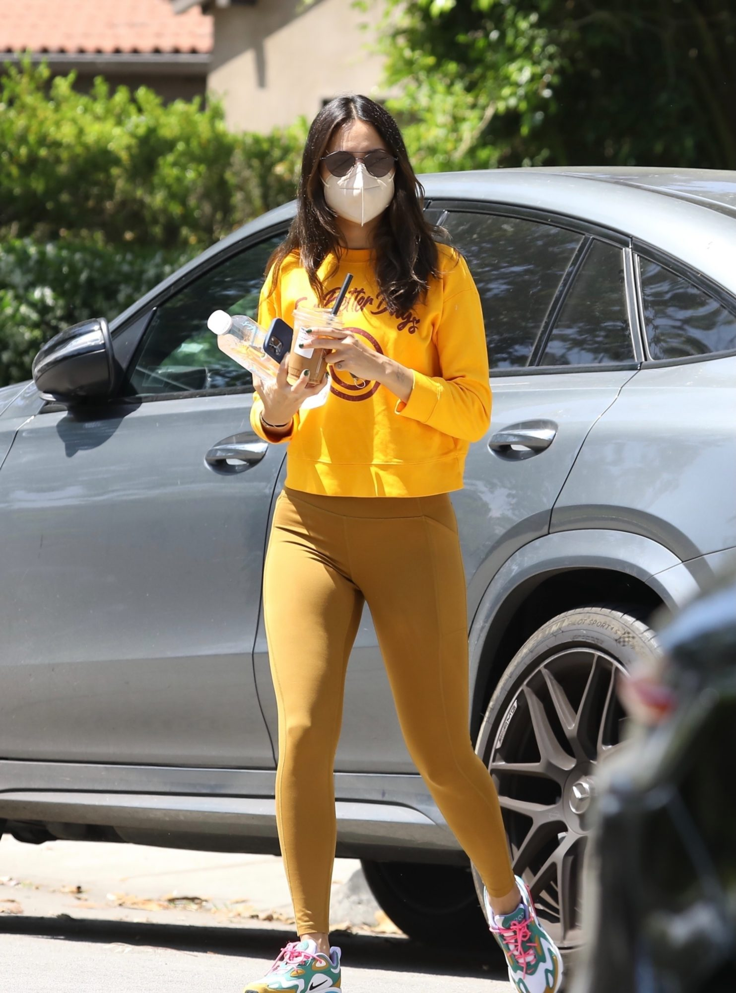 Eiza Gonzalez in Gold Leggings, Yellow Sweatshirt & Newly Dyed Darker Hair