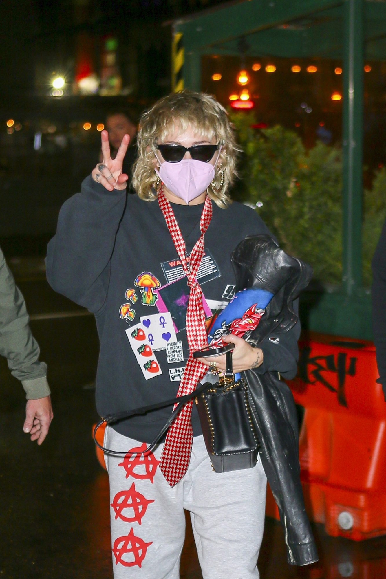 Miley Cyrus Flashes a Peace Sign as she Arrives in NYC Ahead of SNL Performance