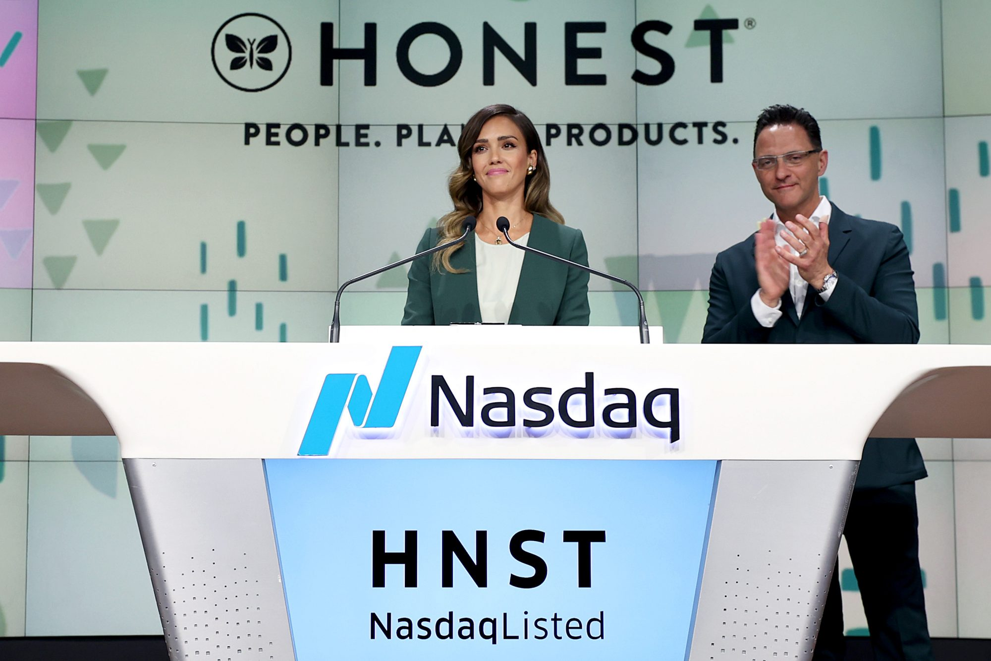 The Honest Company founder and chief creative officer Jessica Alba and The Honest Company CEO Nick Vlahos ring the Nasdaq Stock Market opening bell to mark the company's IPO at NASDAQ MarketSite