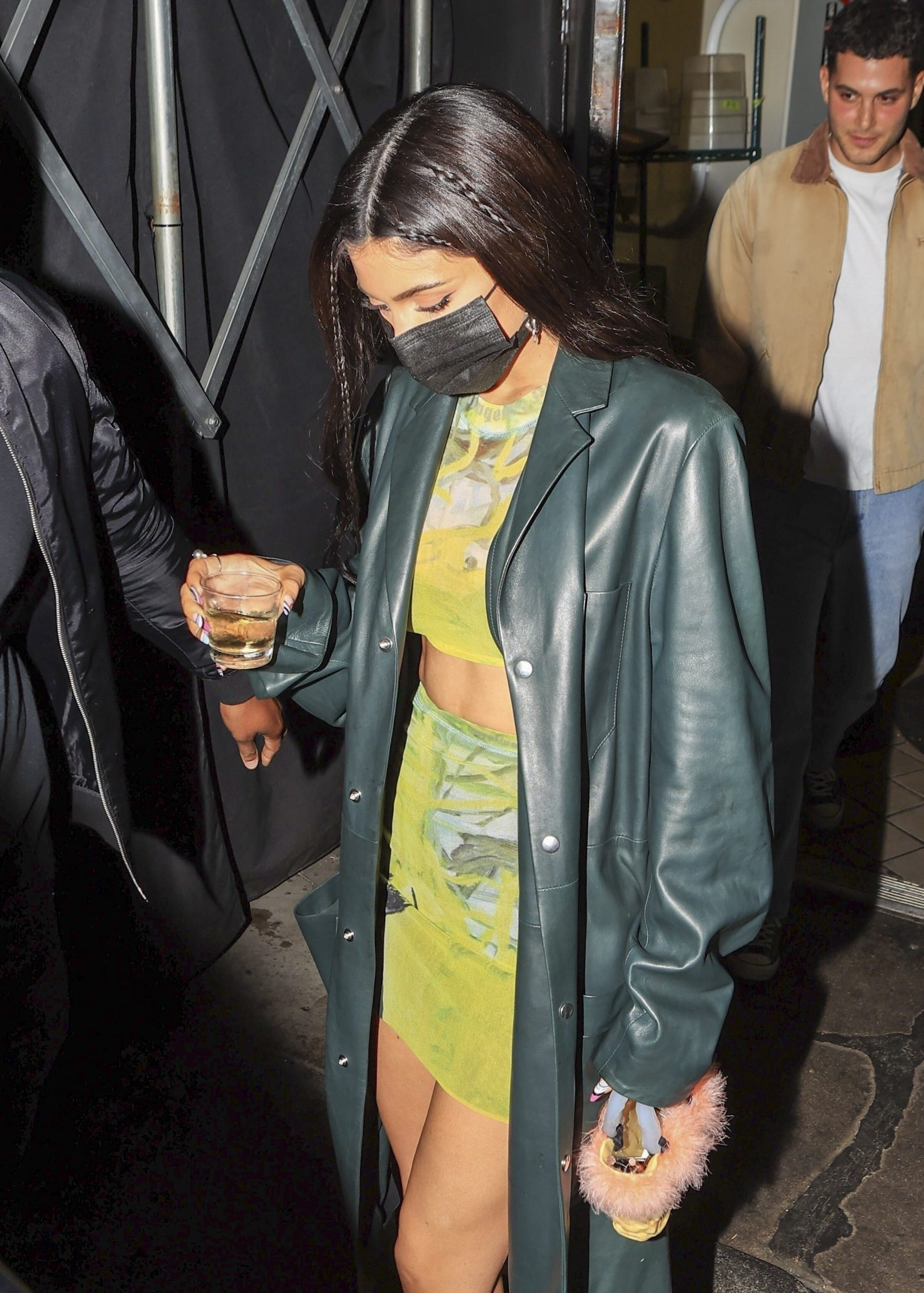 Kylie Jenner Carries a Shot of Tequila while leaving The Nice Guy