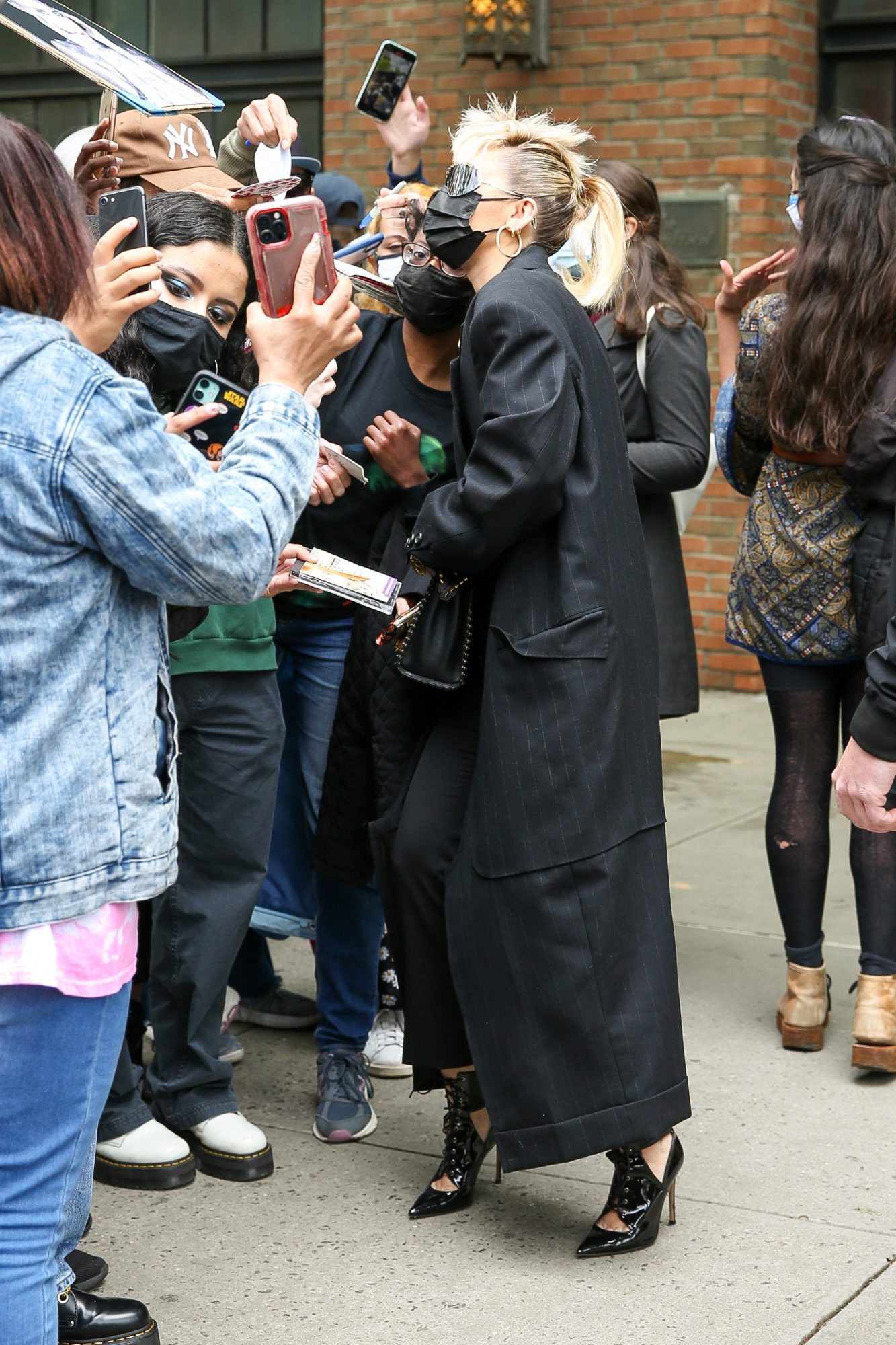 Miley Cyrus Seen Wearing a Long Black Coat as Leaving her hotel in NYC