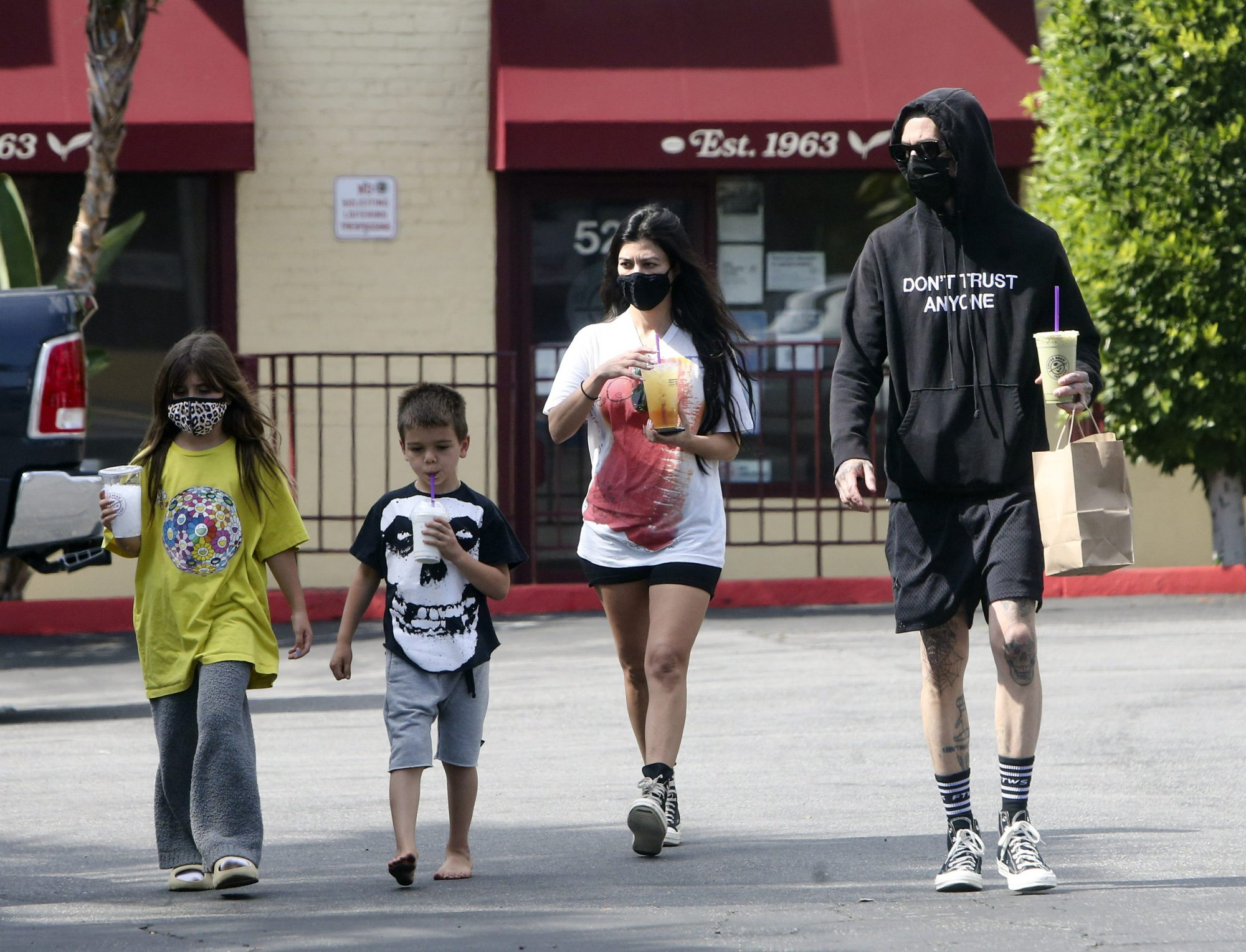 Kourtney Kardashian & Travis Barker Stop for Snacks with the Kids During a Memorial day Road Trip
