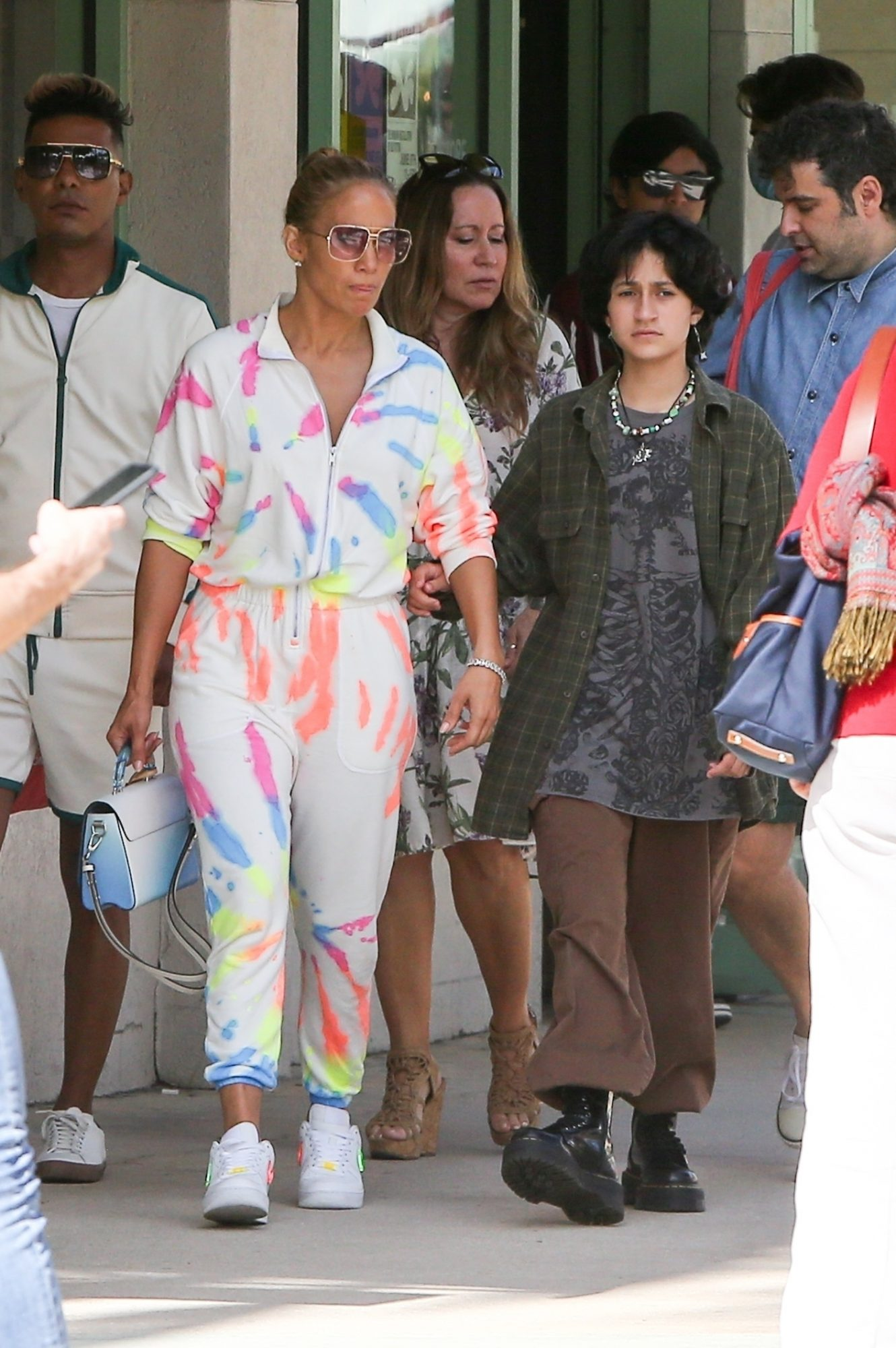 Jennifer Lopez Rocks a Multicolored Jumpsuit for Outing with Kids