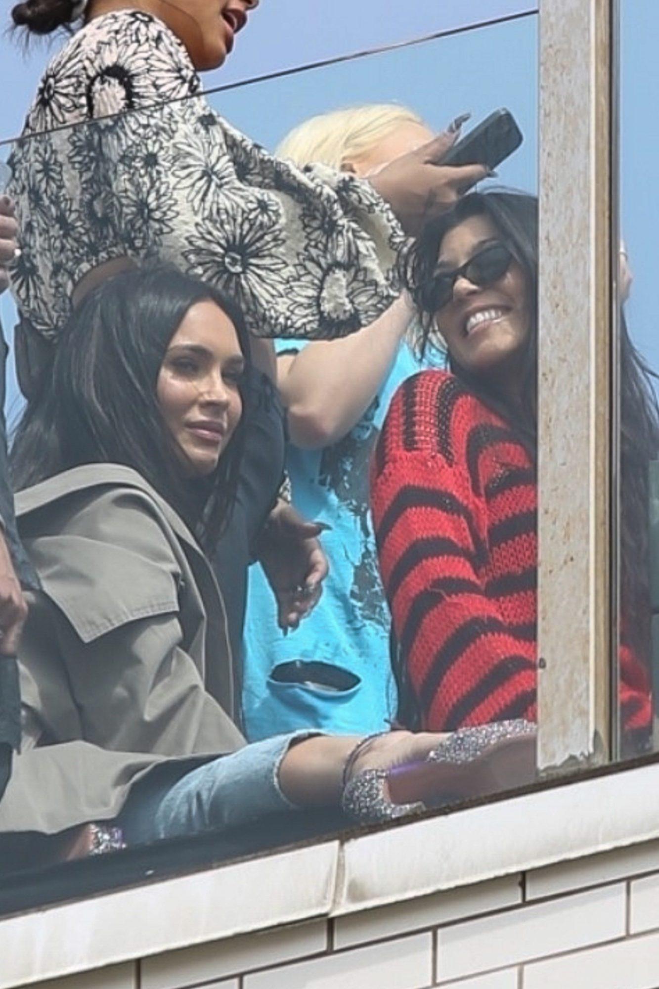 Megan Fox Bonds with Kourtney Kardashian as they Watch MGK and Travis Barker's Rooftop Performance