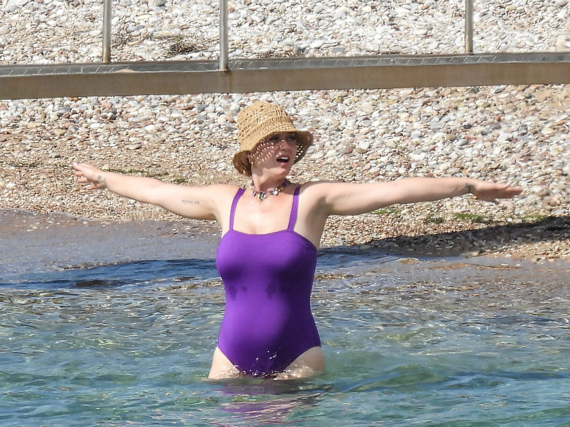 Katy Perry Wows in a Purple Swimsuit on Greek Family Vacation