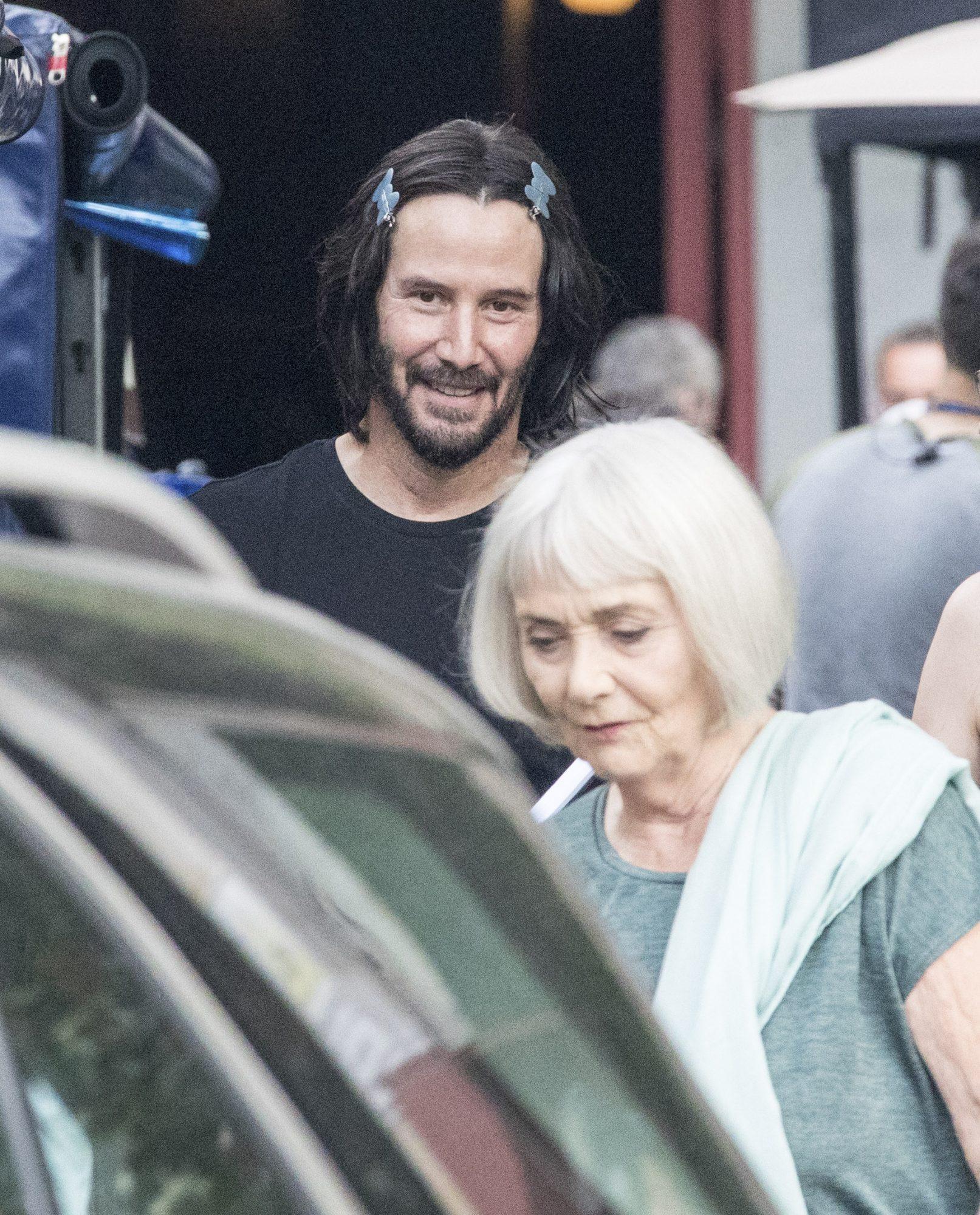 First Photos of Keanu Reeves with Long Dark Hair & Grips Filming 'John Wick'