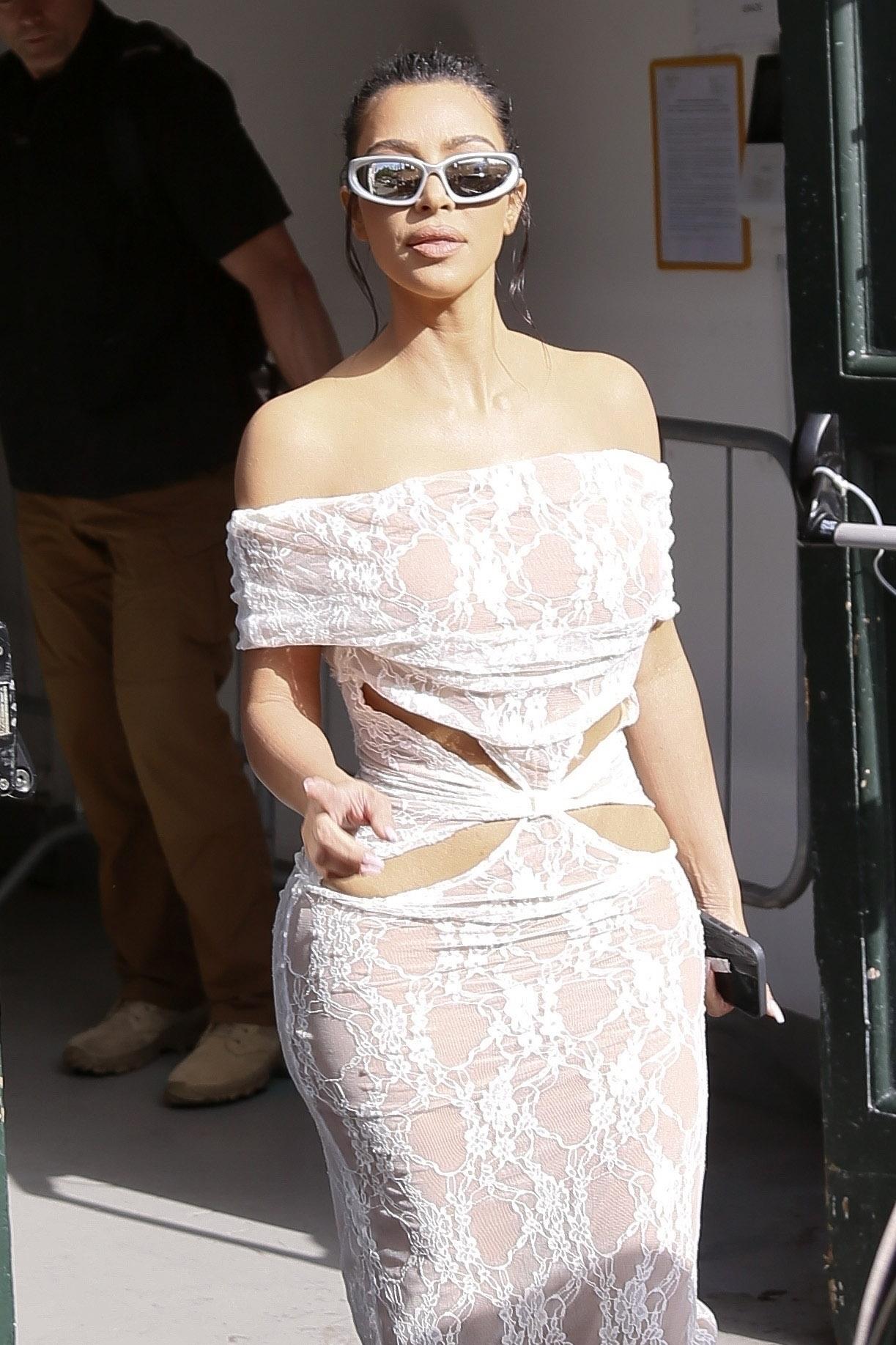 Kim Kardashian Tours the Vatican Wearing a Stunning White Lace Dress