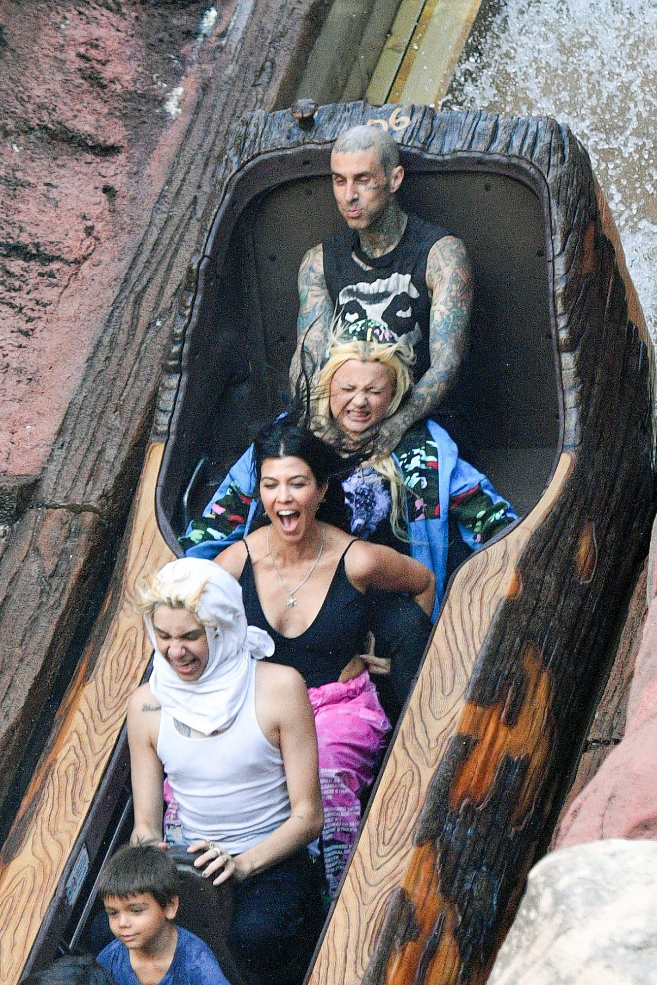 Kourtney Kardashian and Travis Barker Take the Kids to Disneyland
