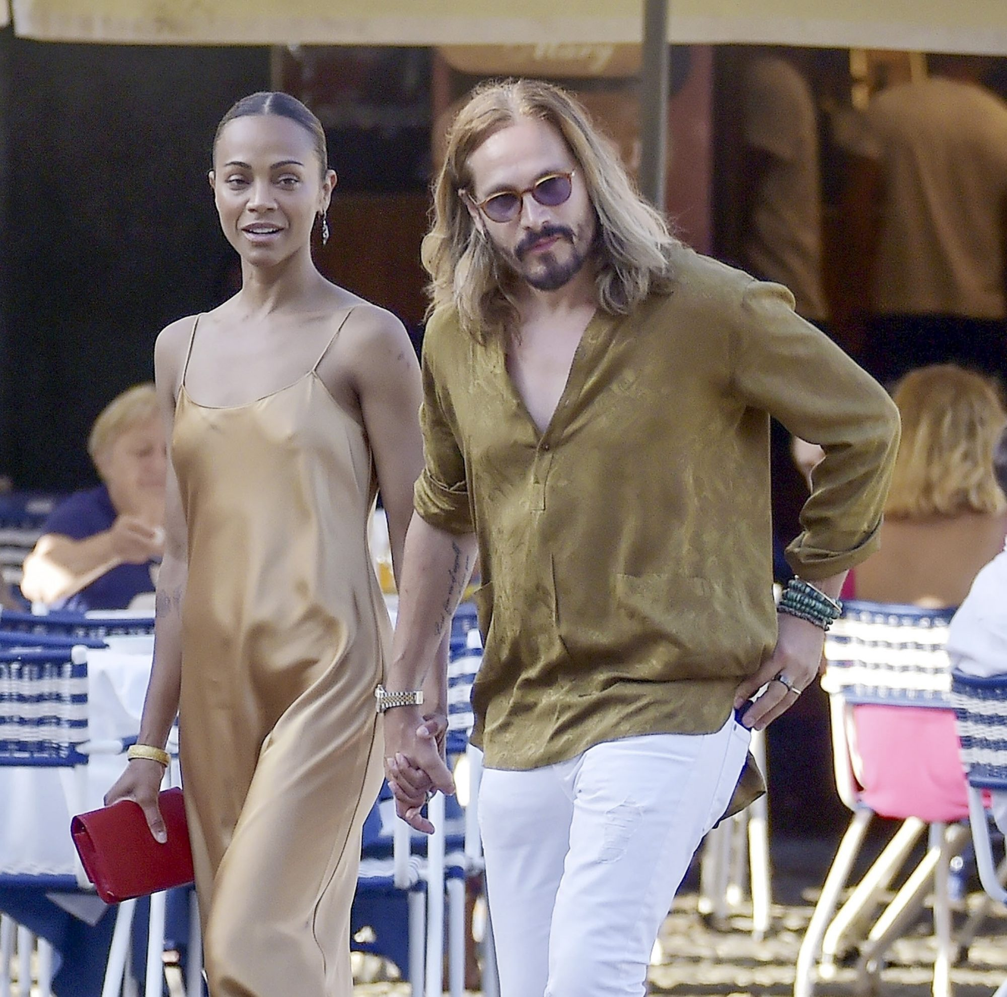 Zoe Saldana in a Gold Silky Dress Out for Dinner with Husband Marco Perego in Portofino