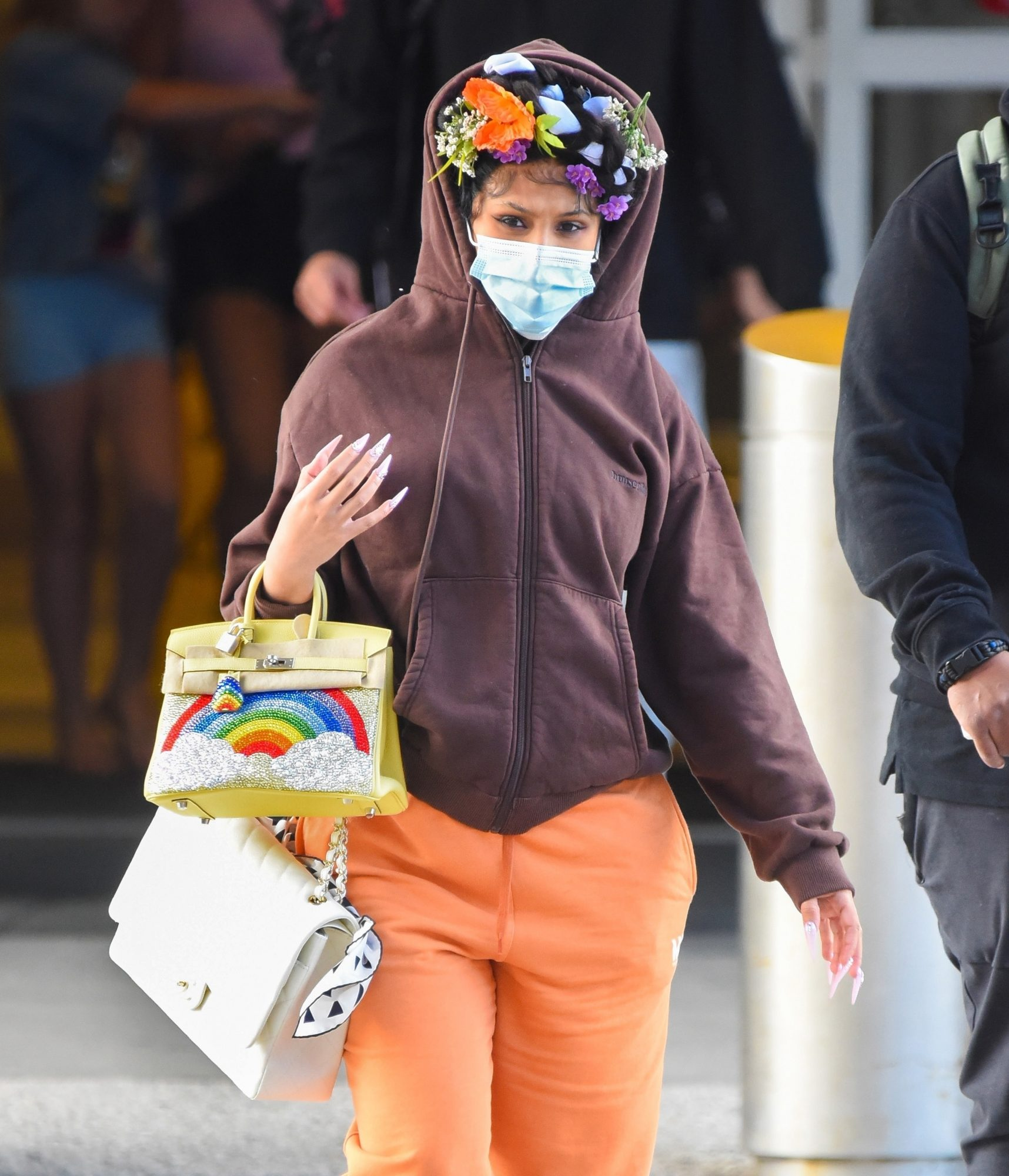 Pregnant Cardi B Jazzes Up Her Casual Airport Look By Wearing A Floral Headband
