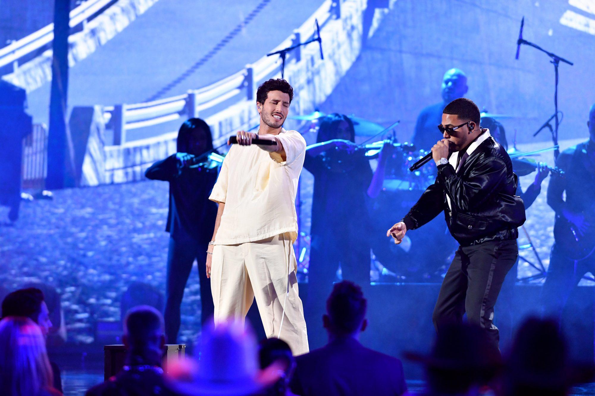 Sebastian Yatra and Myke Towers perform onstage at Premios Juventud 2021 at Watsco Center