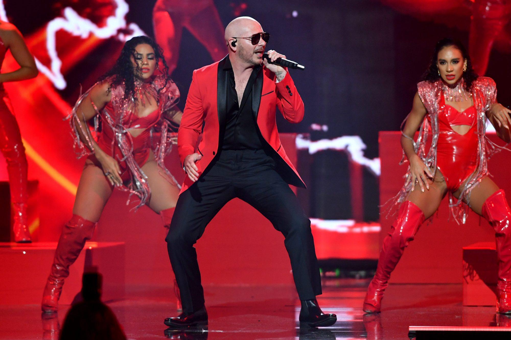 Pitbull performs onstage at Premios Juventud 2021 at Watsco Cente