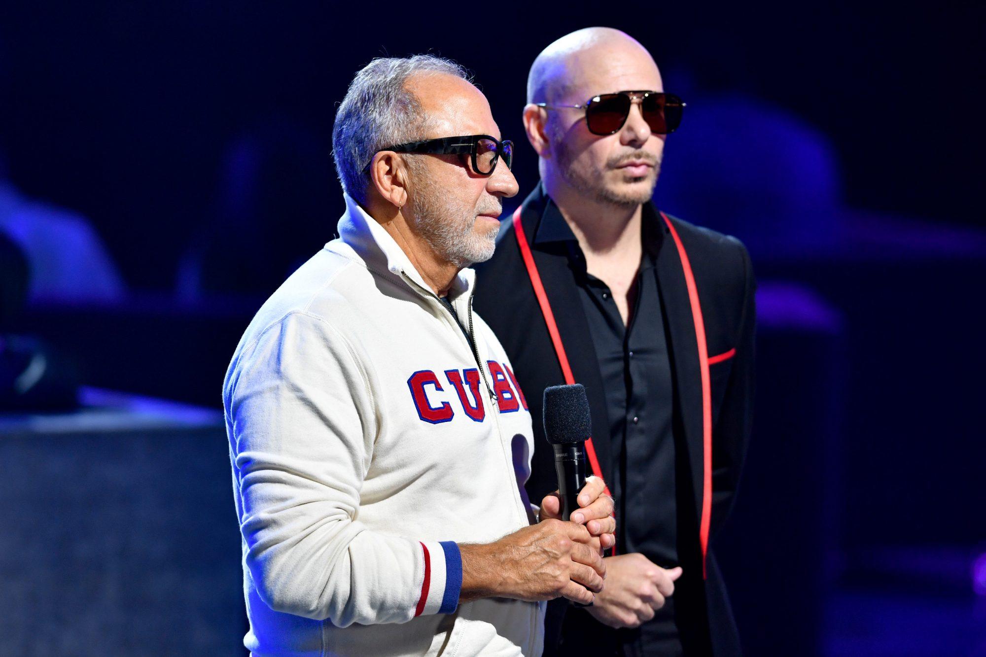 Emilio Estefan and Pitbull speak onstage at Premios Juventud 2021 at Watsco Center pidem ayuda a Cuba