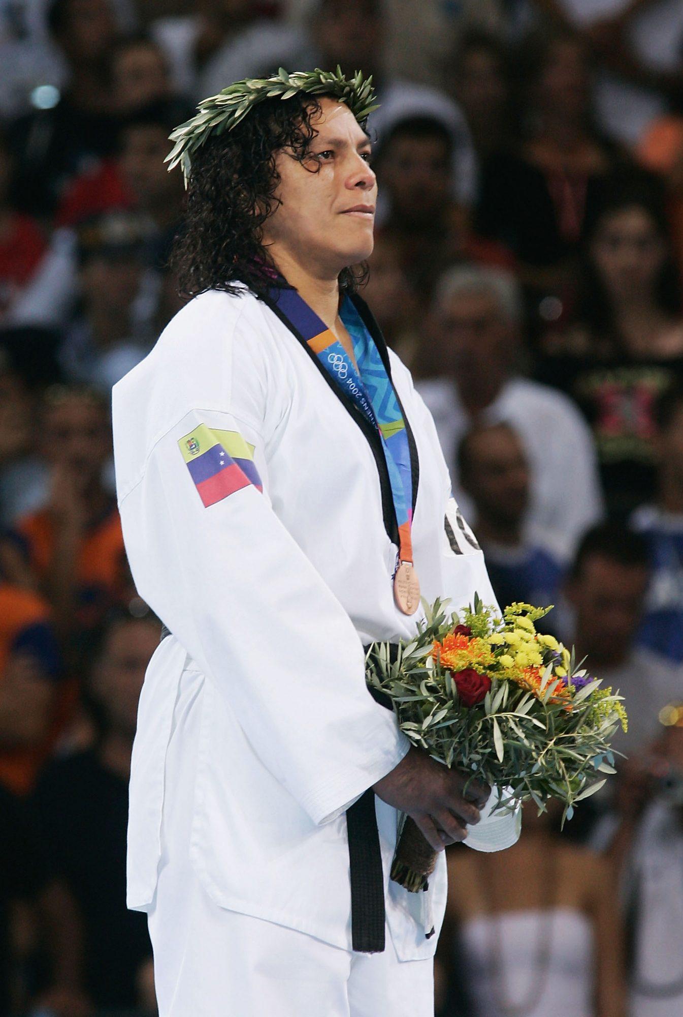 La taekwondista es la única deportista venezolana que ha sido distinguida con dos preseas olímpicas. Barcelona 1992 y Atenas 2004 fueron las dos ediciones de Juegos Olímpicos en los que la atleta logró llevarse medallas de bronce.