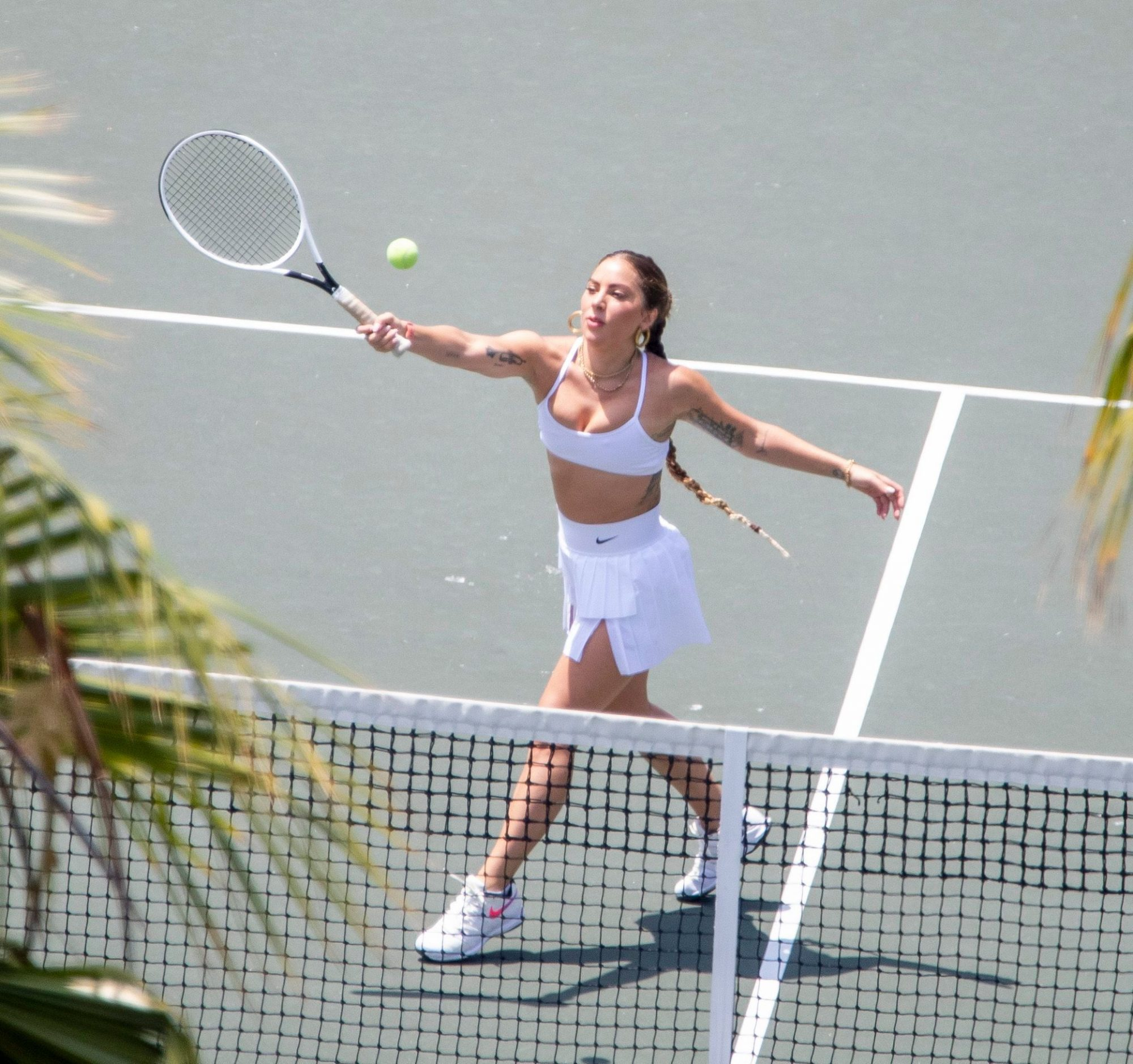 Lady Gaga Puts on an Athletic Display while Taking Tennis Lessons