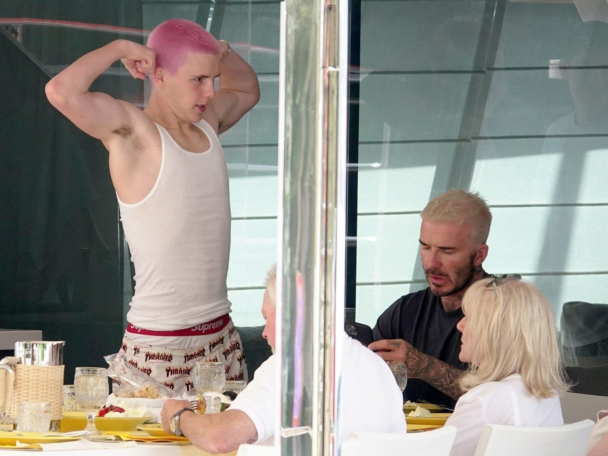 Cruz Beckham Shows Off the Big Guns and Pink Hair on a Yacht with David and Harper