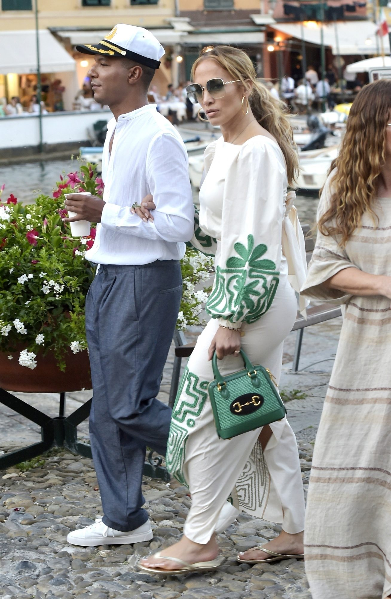 Jennifer Lopez Enjoys Dinner with Wine in Portofino Wearing a Starbucks Inspired Dress