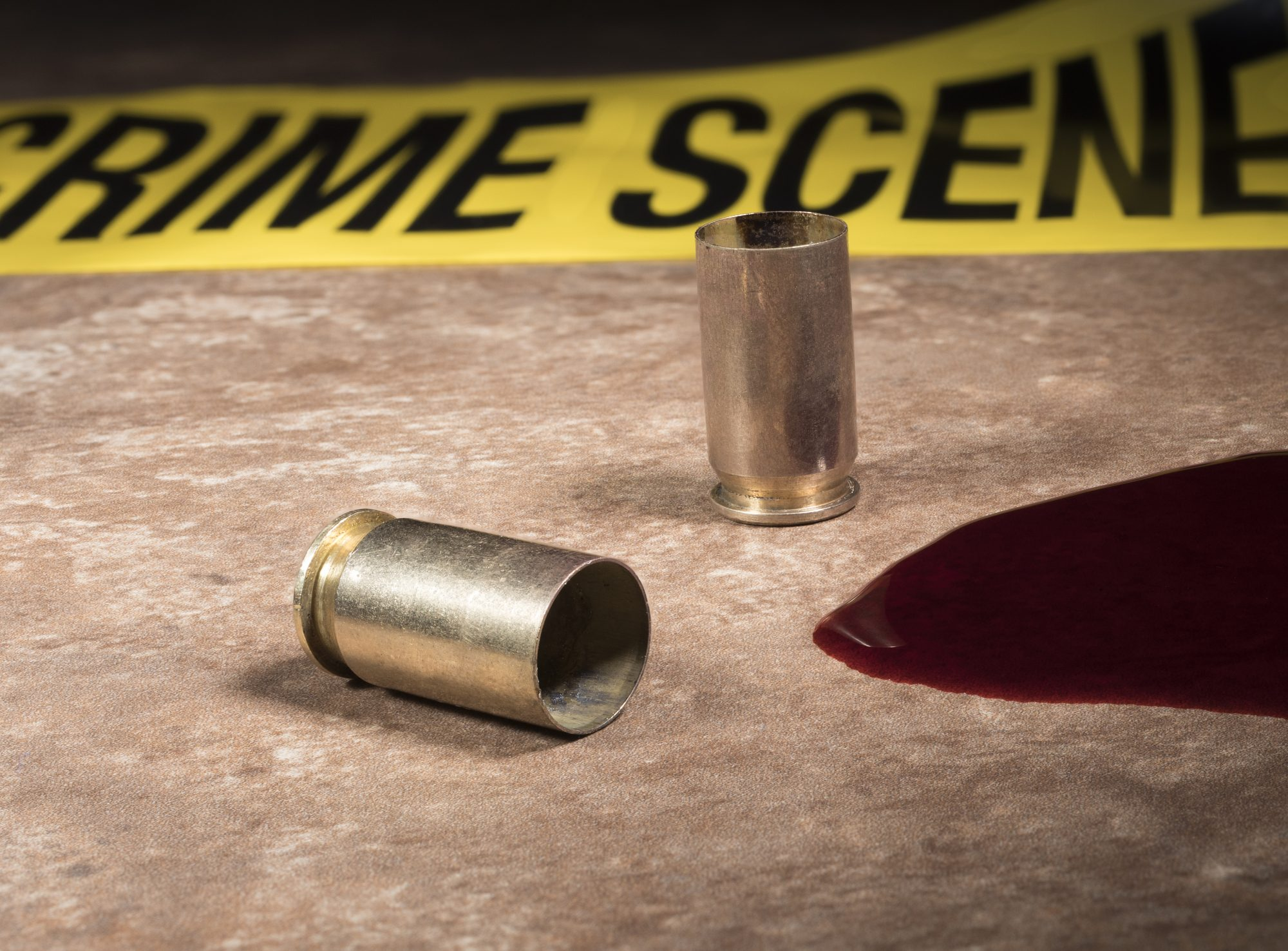 Handgun brass with blood and police tape