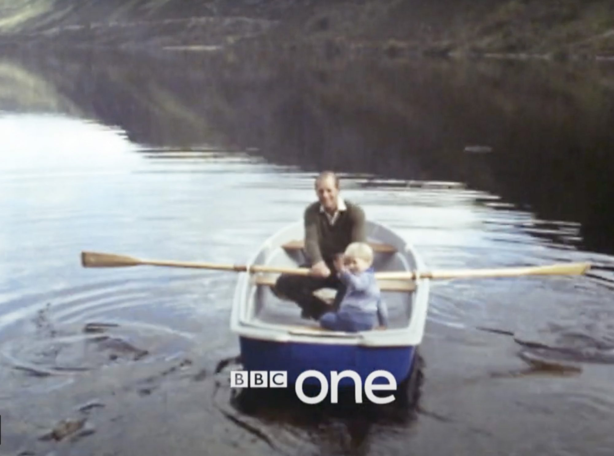 Prince Philip rowing with young Prince Edward