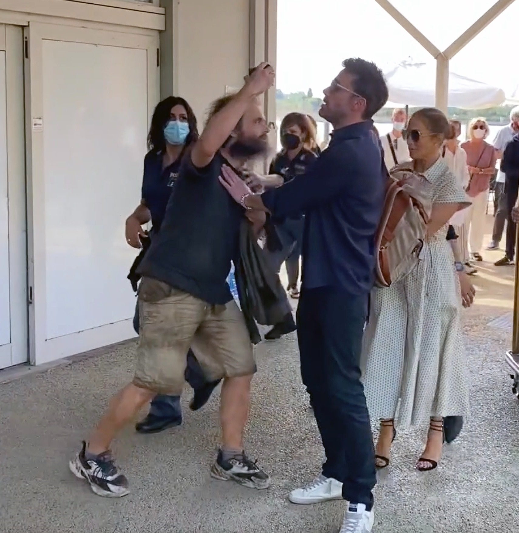 Ben Affleck Protects JLo as he Pushes Away a Crazy Fan in Venice