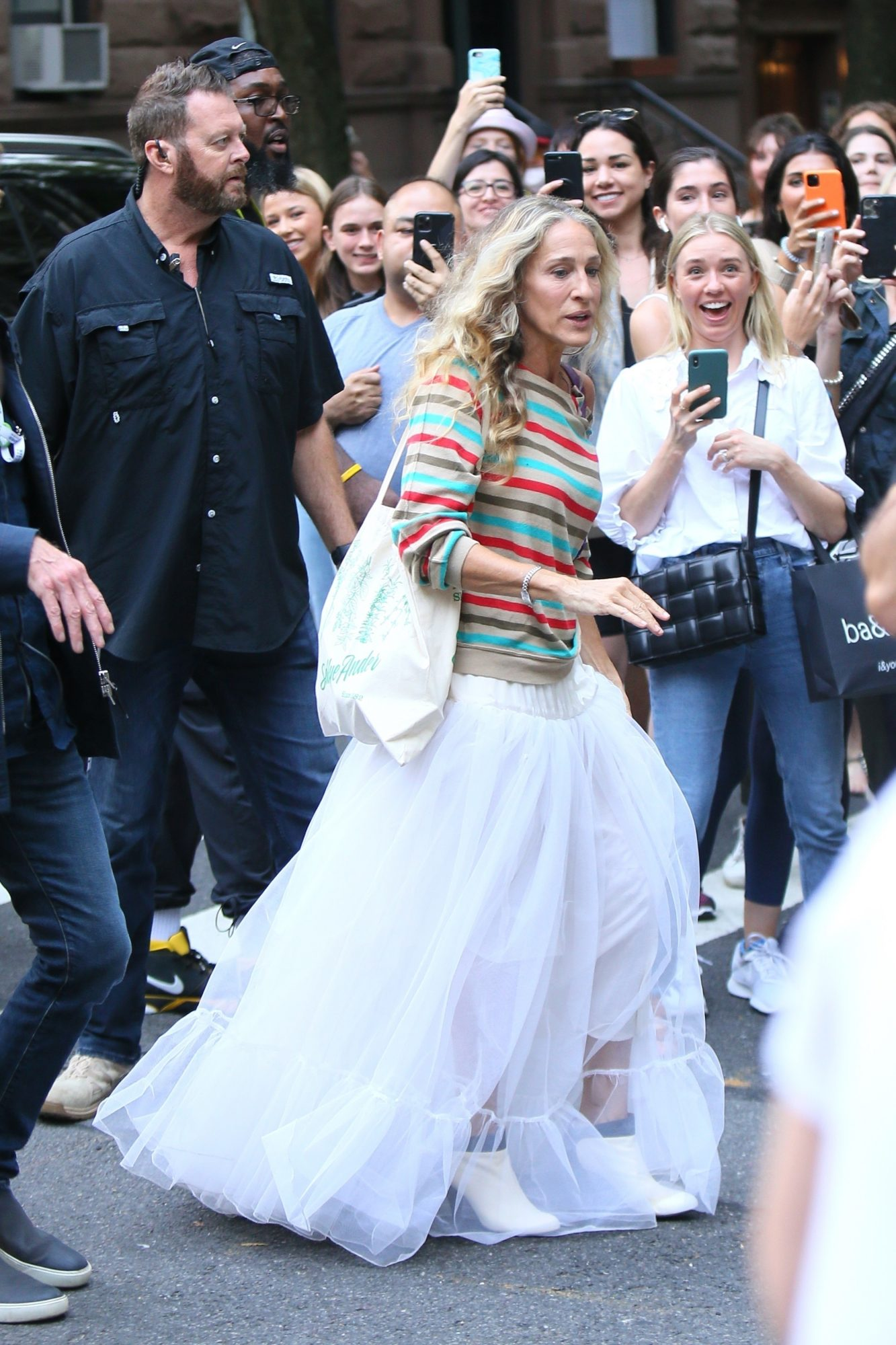 Sarah Jessica Parker Looks Great a White Gown as she Films 'And Just Like That'