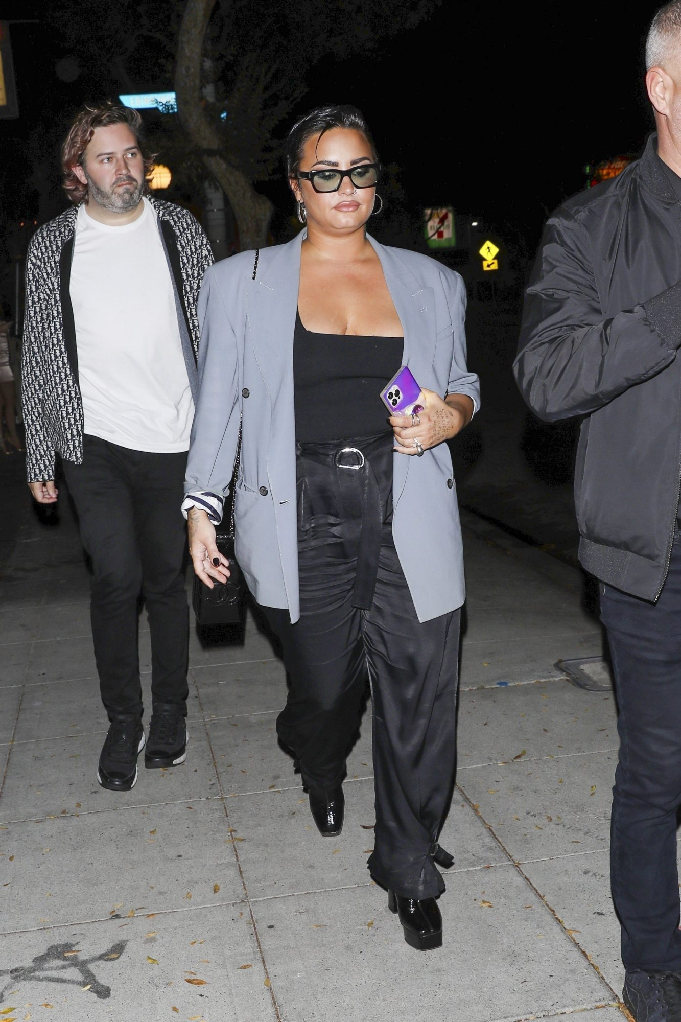 Demi Lovato Shows Off her Cleavage while Going to a Party in West Hollywood
