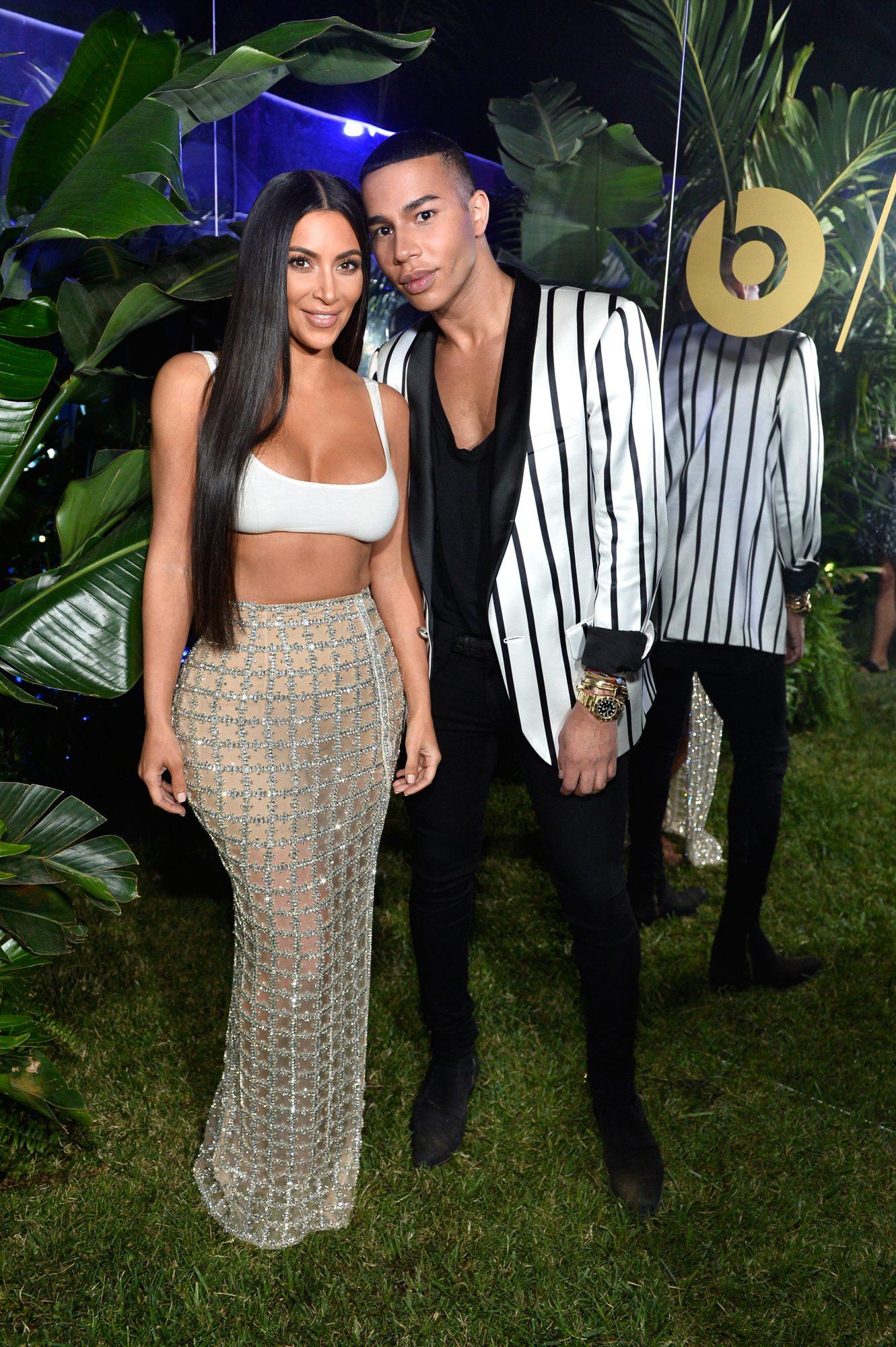 Kim Kardashian (L) and designer Olivier Rousteing