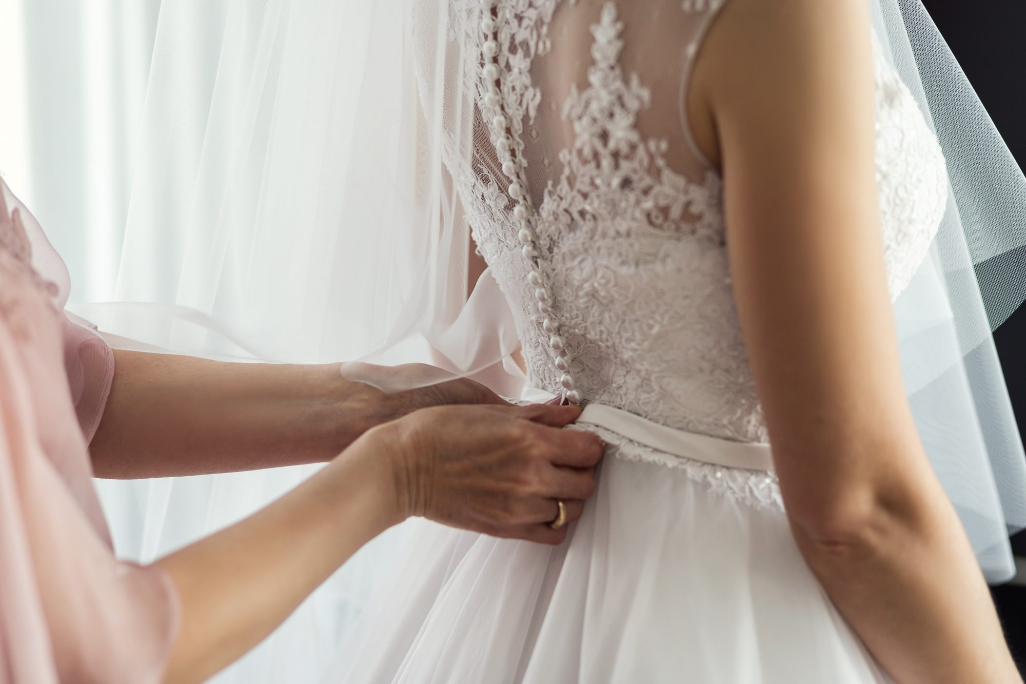 Morning of the bride, the bride wears a dress, a wedding, a beautiful dress