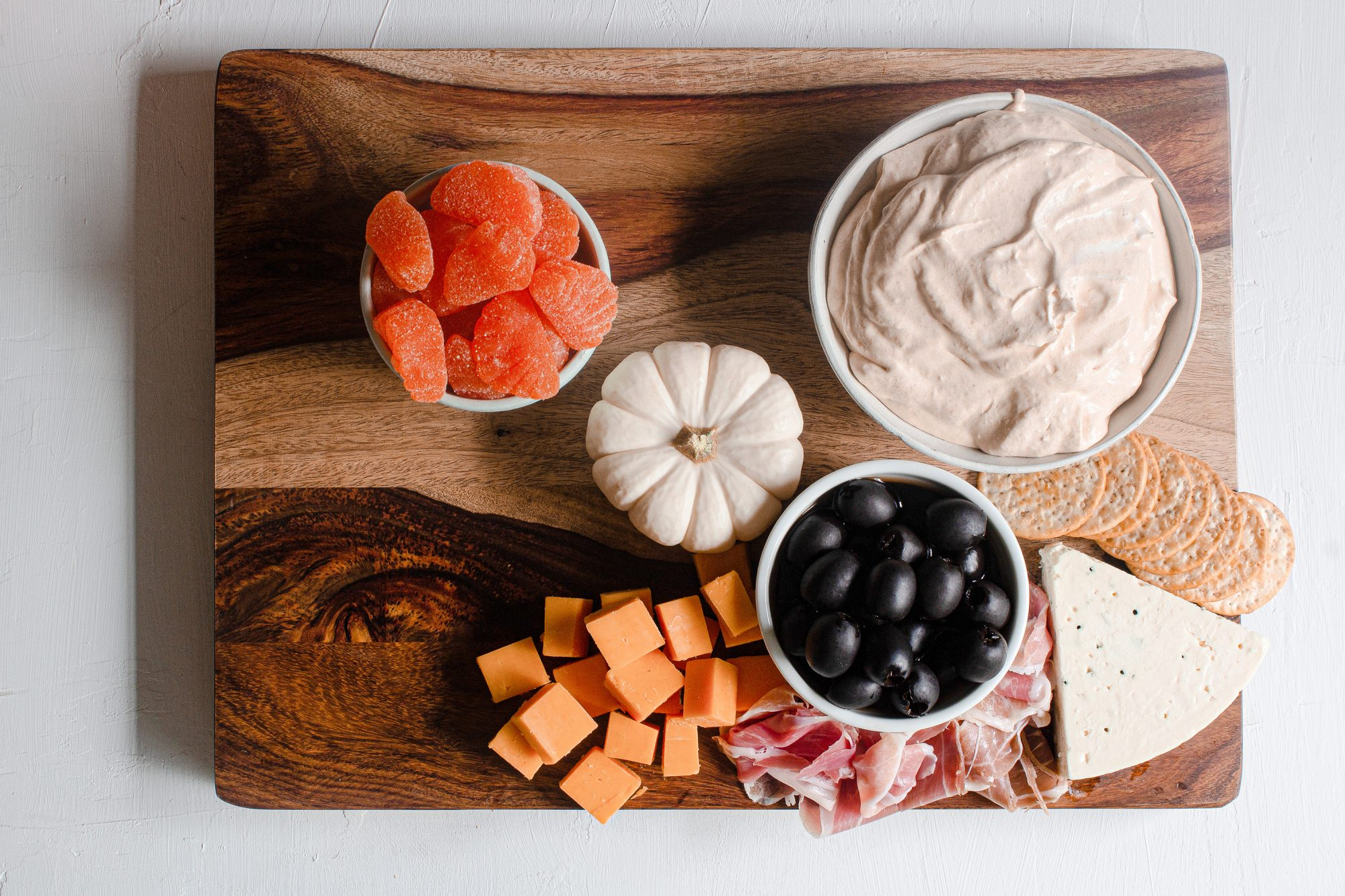halloween charcuterie board with cheeses and meats addes