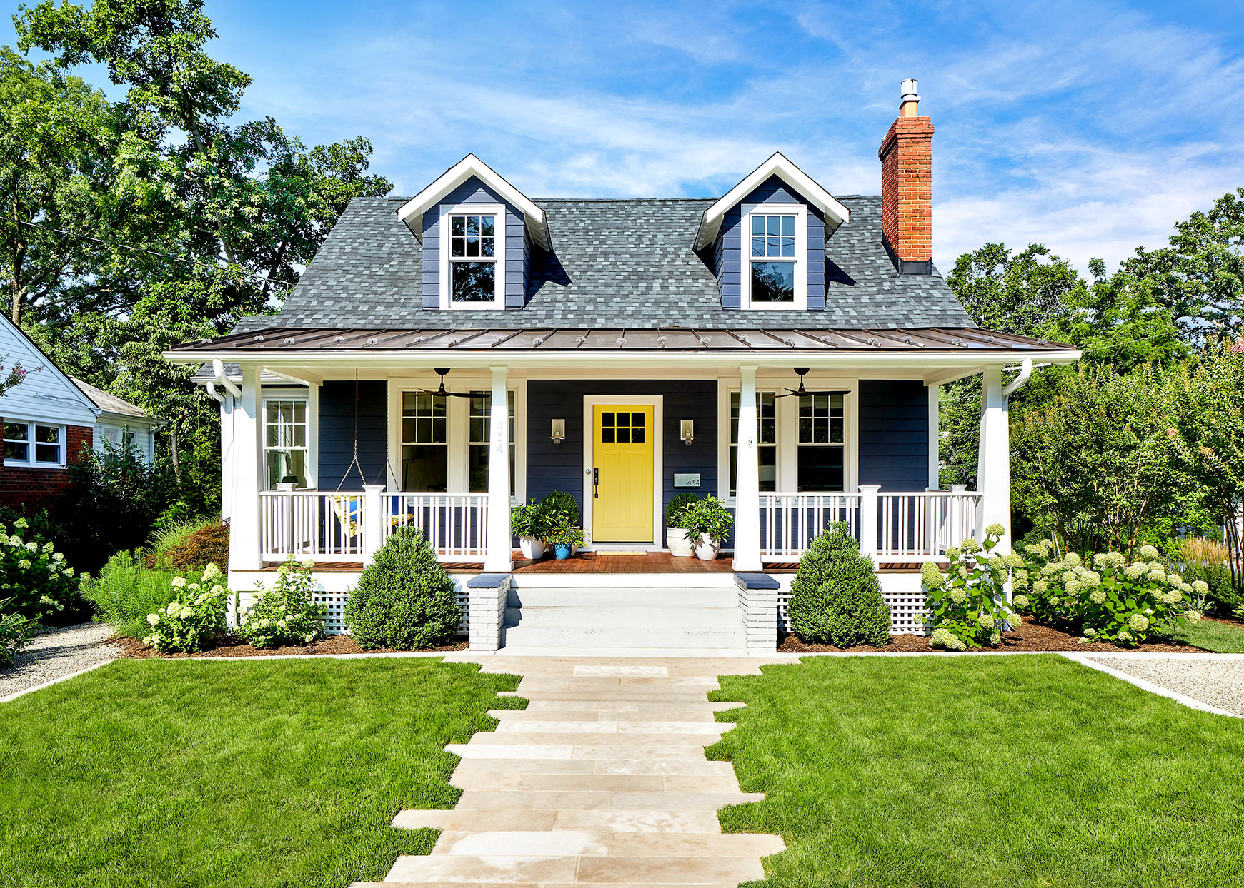Front of blue house with white accents