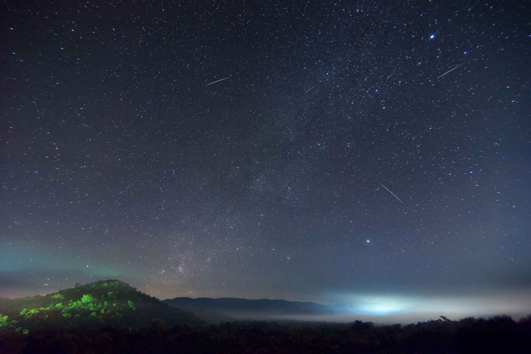 Milky way on hill with Leonid meteor shower