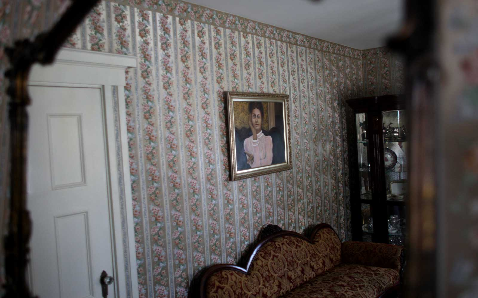 A portrait of Lizzie Borden hangs on a wall at the Lizzie Borden house in Fall River, which is now a bed and breakfast.