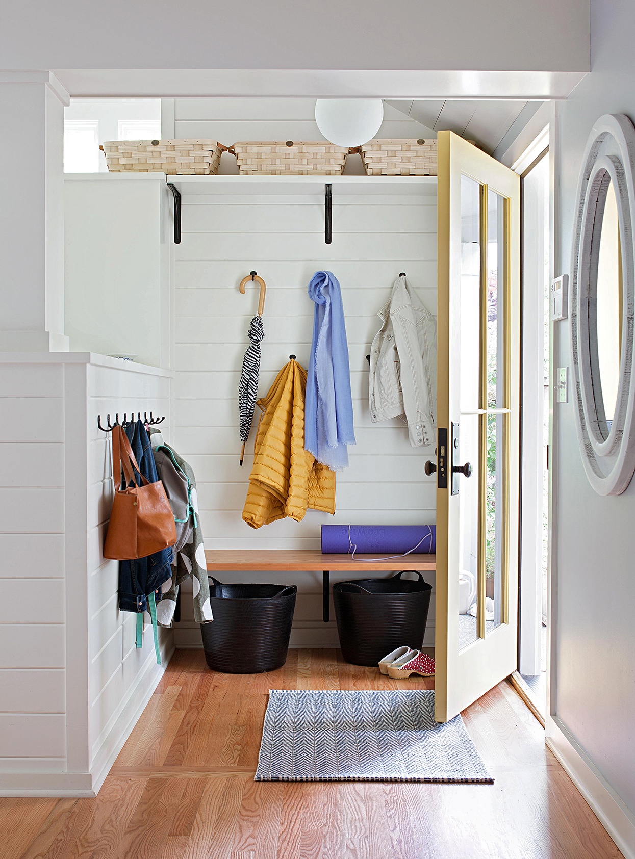 minimalist entryway with bench, baskets and hooks