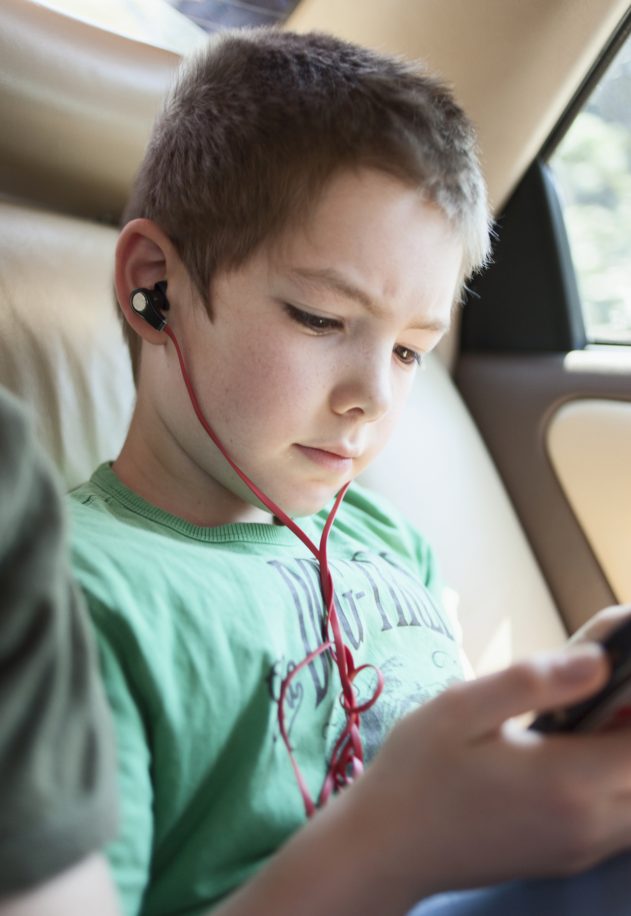 Boy in car with phone