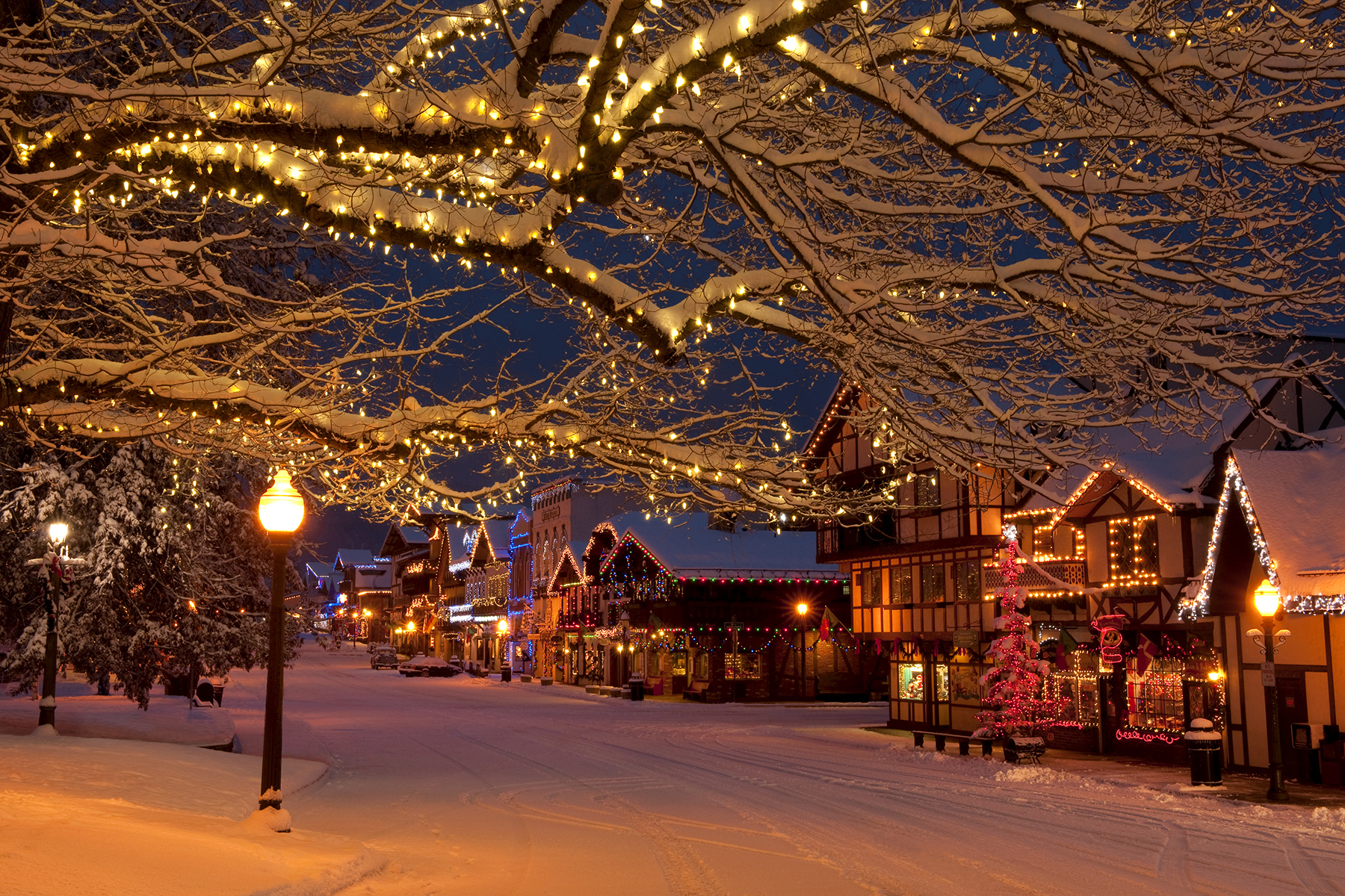 Town street with snow and Christmas lights