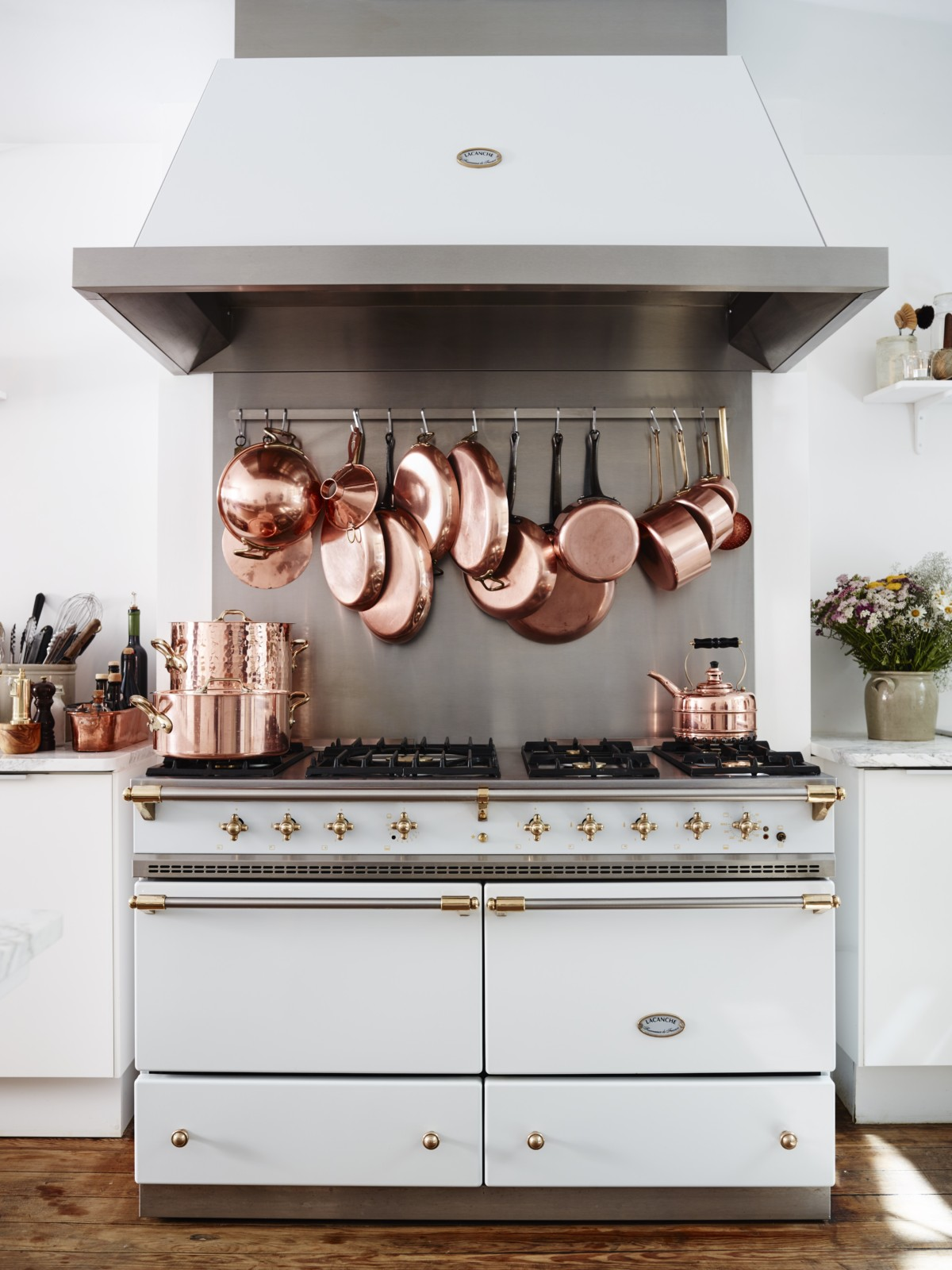 Lacanche Oven Range in white with copper pots and pans hanging