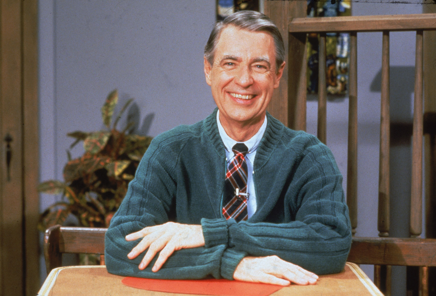 Mr. Rogers wearing a sweater