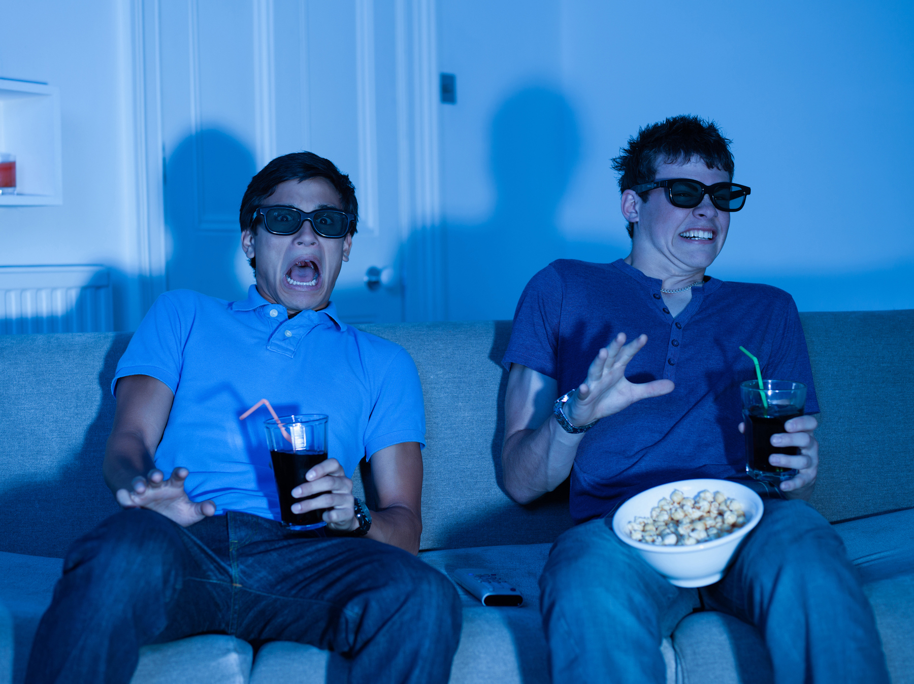 Teen boys watching movie in sunglasses